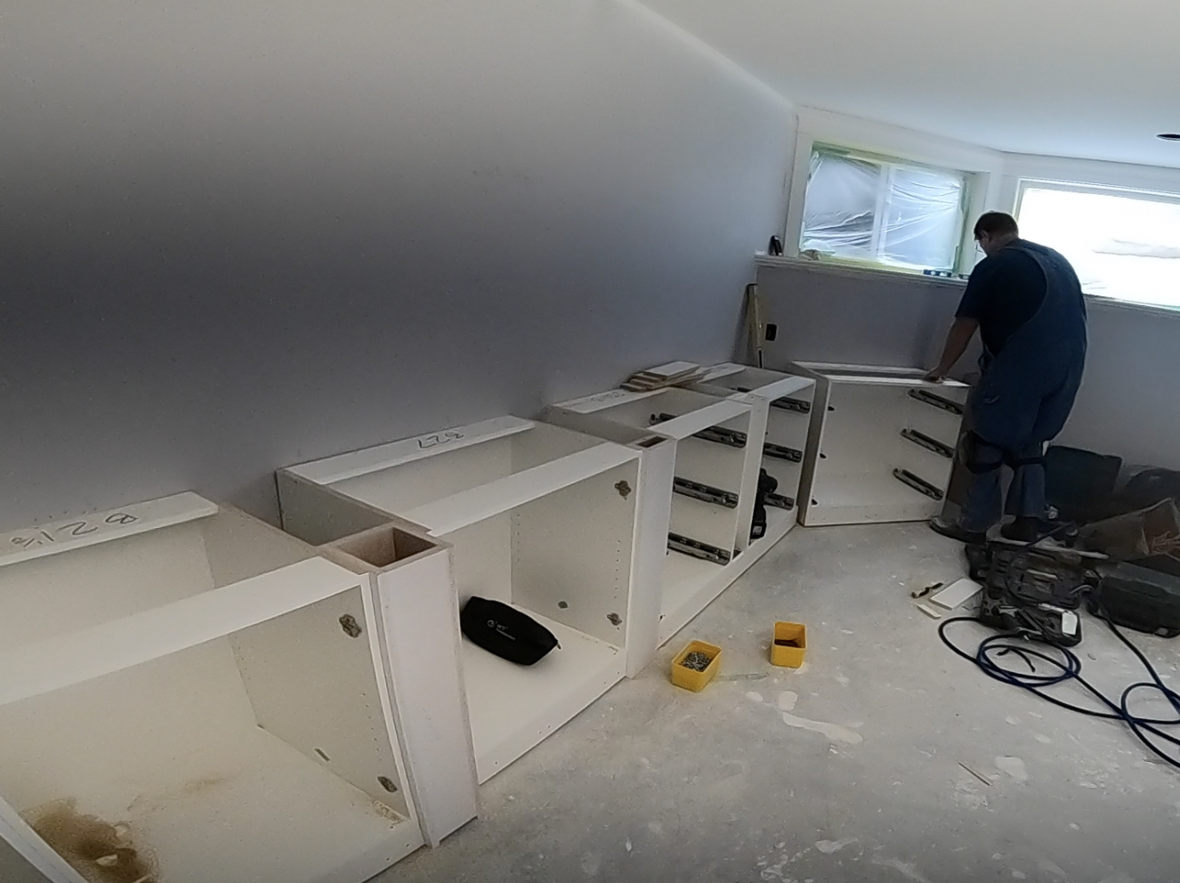 Jay installing the custom cabinet units for this North Vancouver Renovation