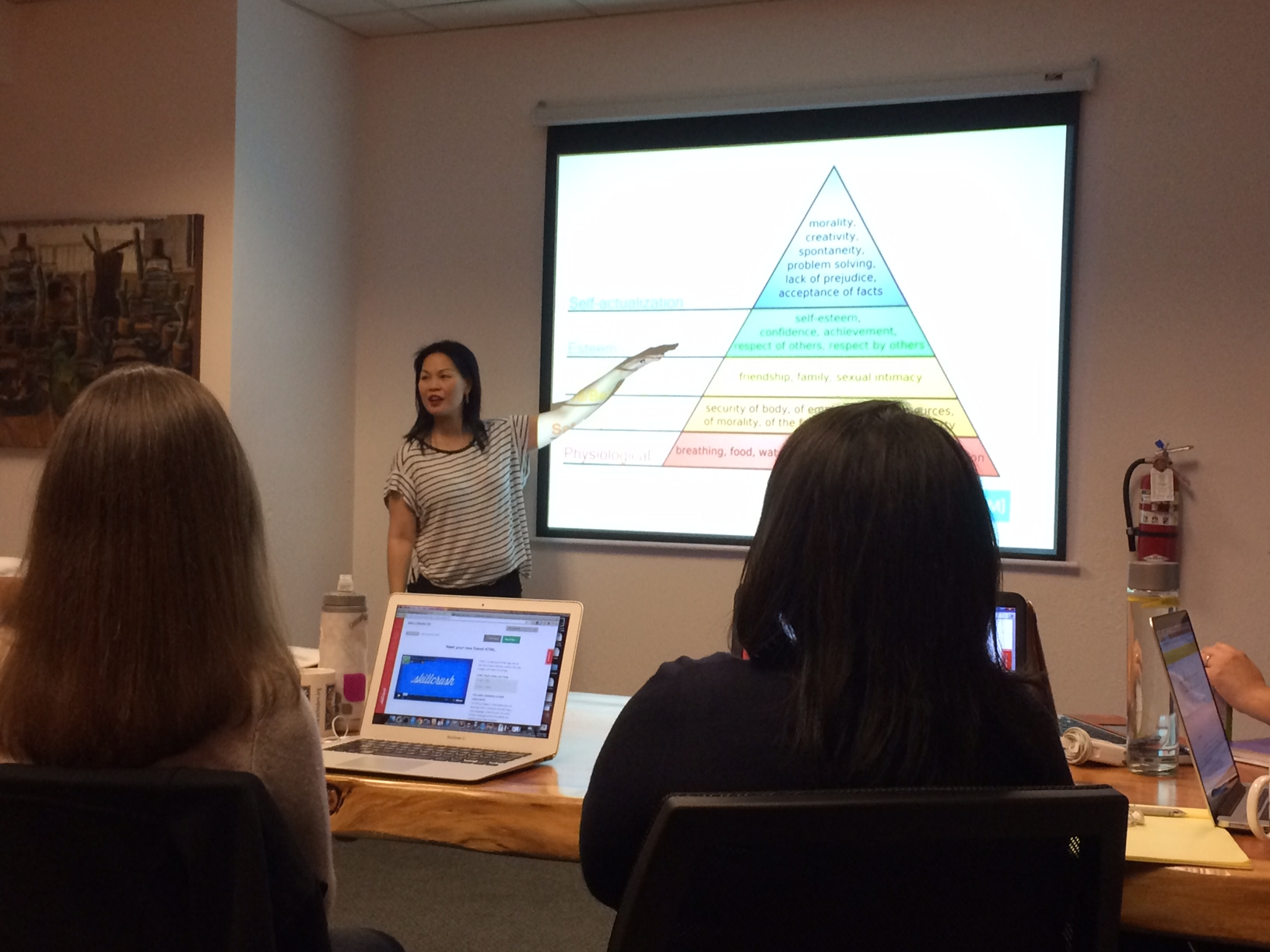 (Why, yes, that is a picture of Maslow's Hierarchy of Needs on the slide.)