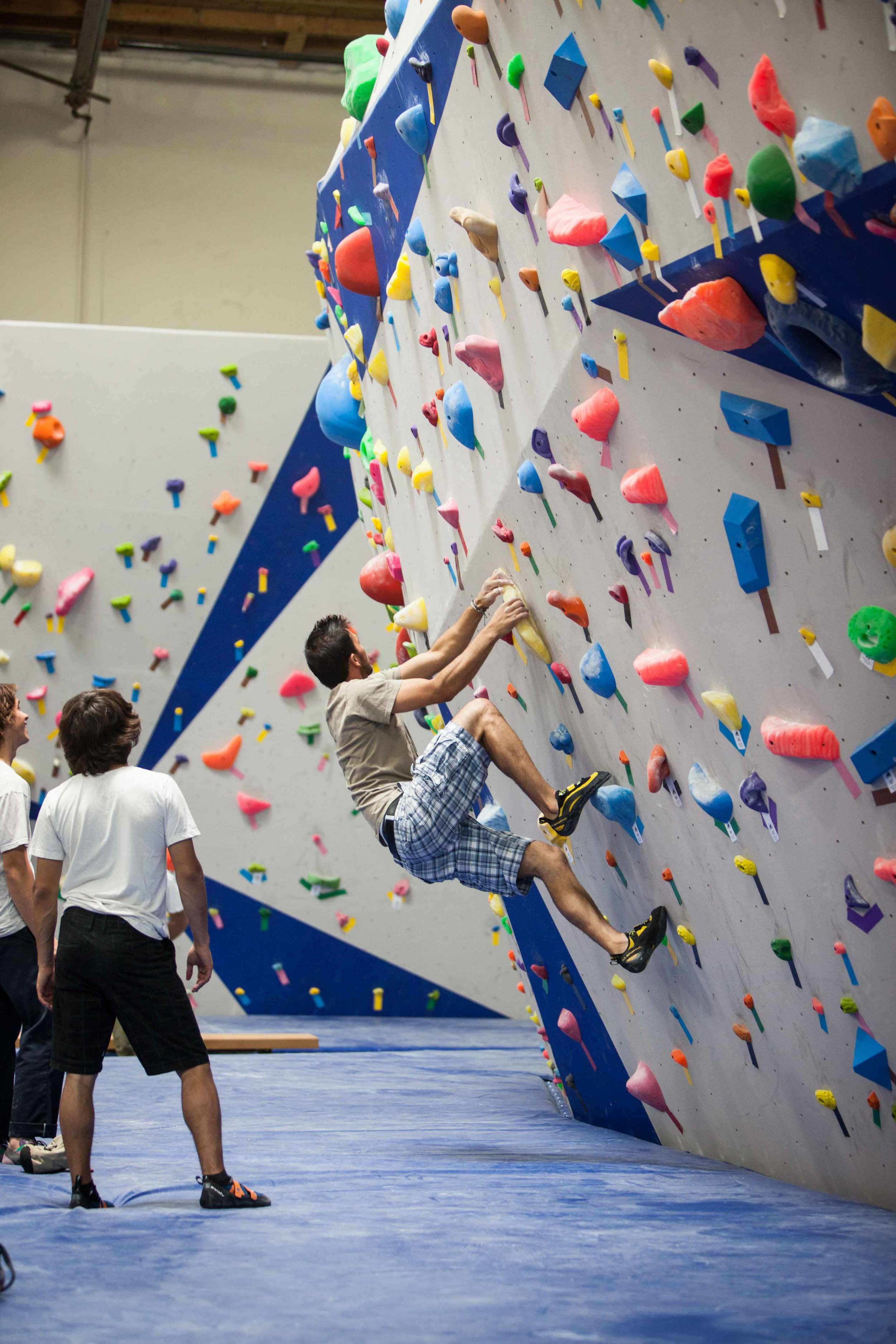 Climber beginning a boulder problem