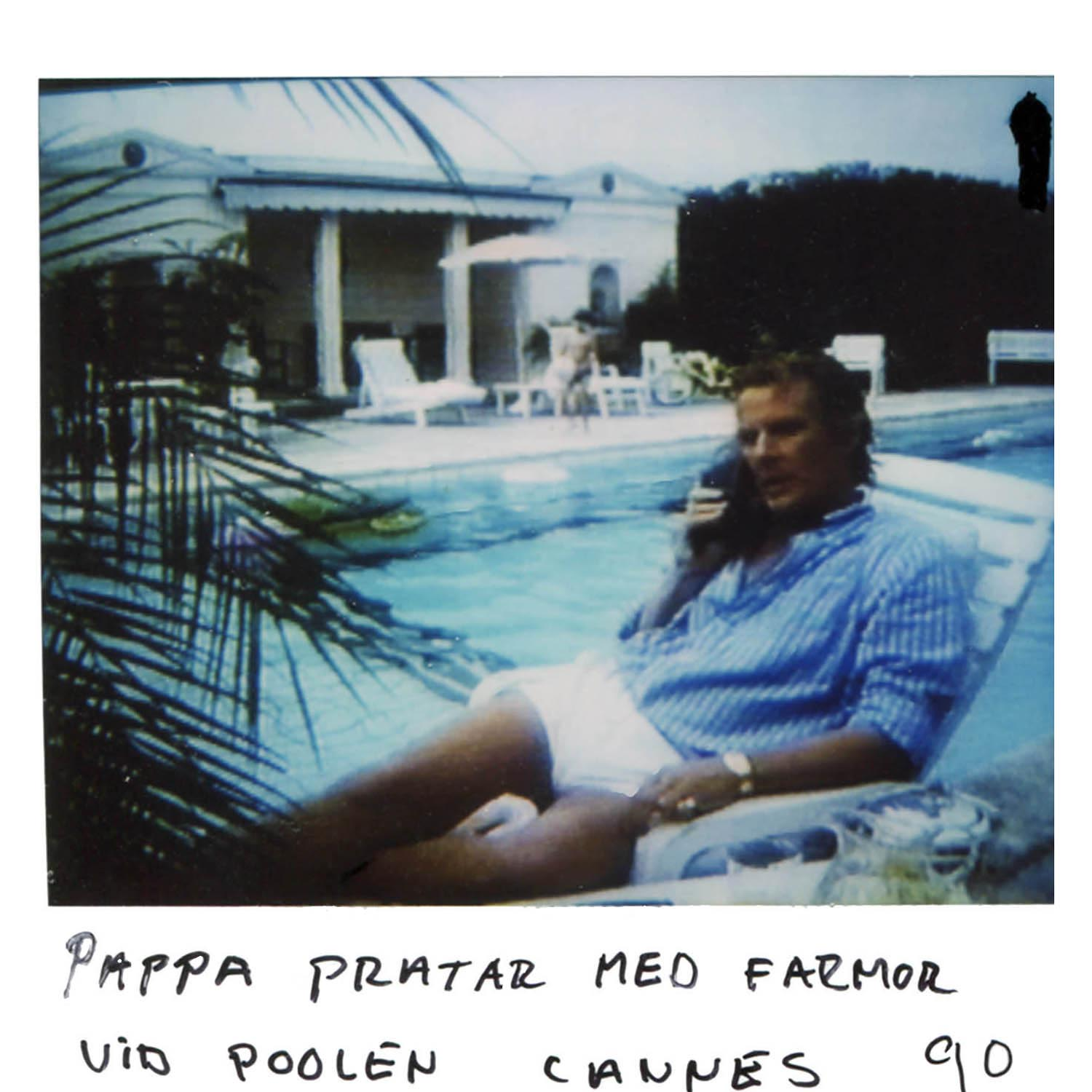 Daddy talks with Granny (on the phone)  by the pool in Cannes -90