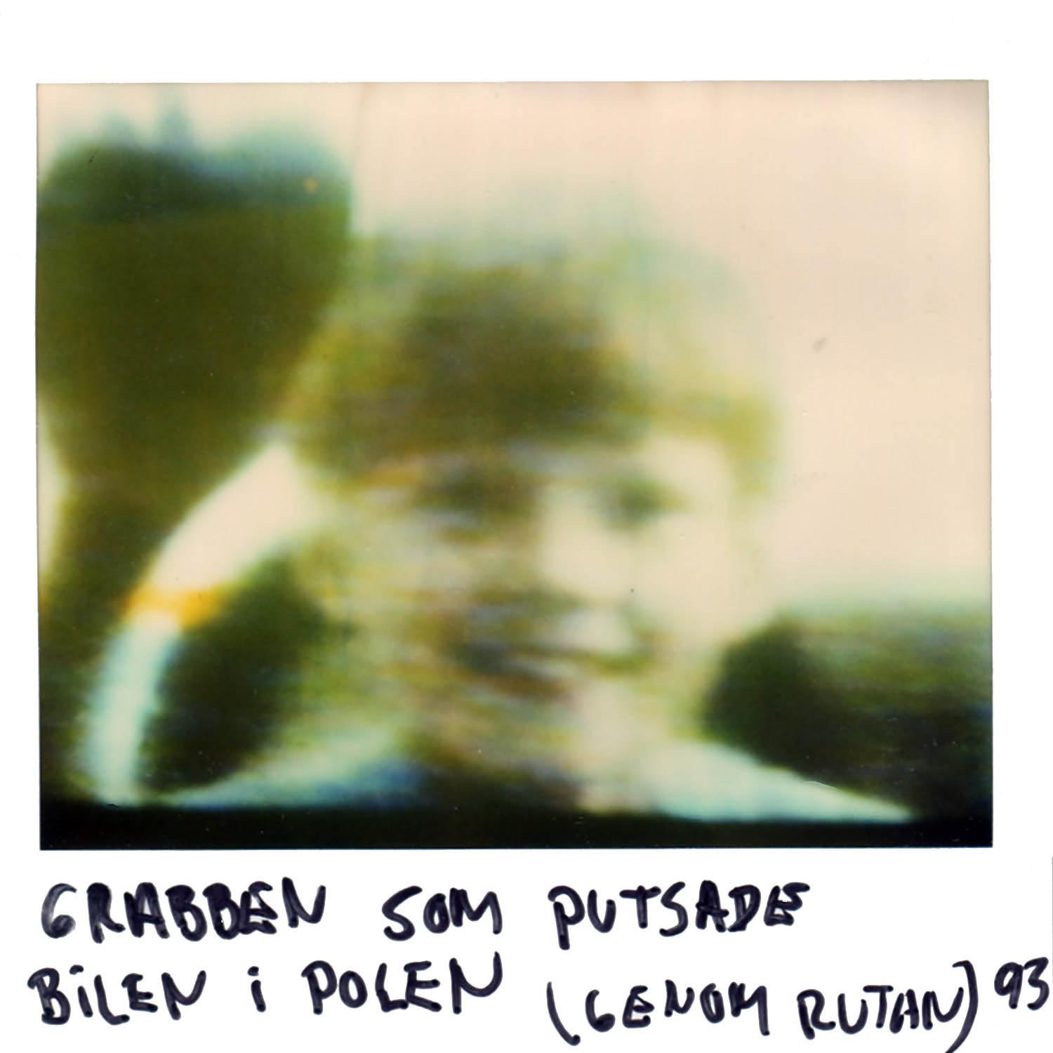 The kid whom cleaned our car in Poland (through the car window)  -93