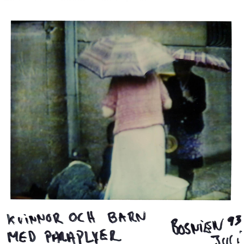 women and children with umbrellas  july  -93 in Sarajevo