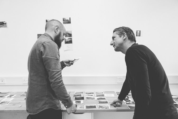 Designer Vinny Gregan and photographer Dara McGrath working on image selection and sequencing for his photobook ''Project Cleansweep'.