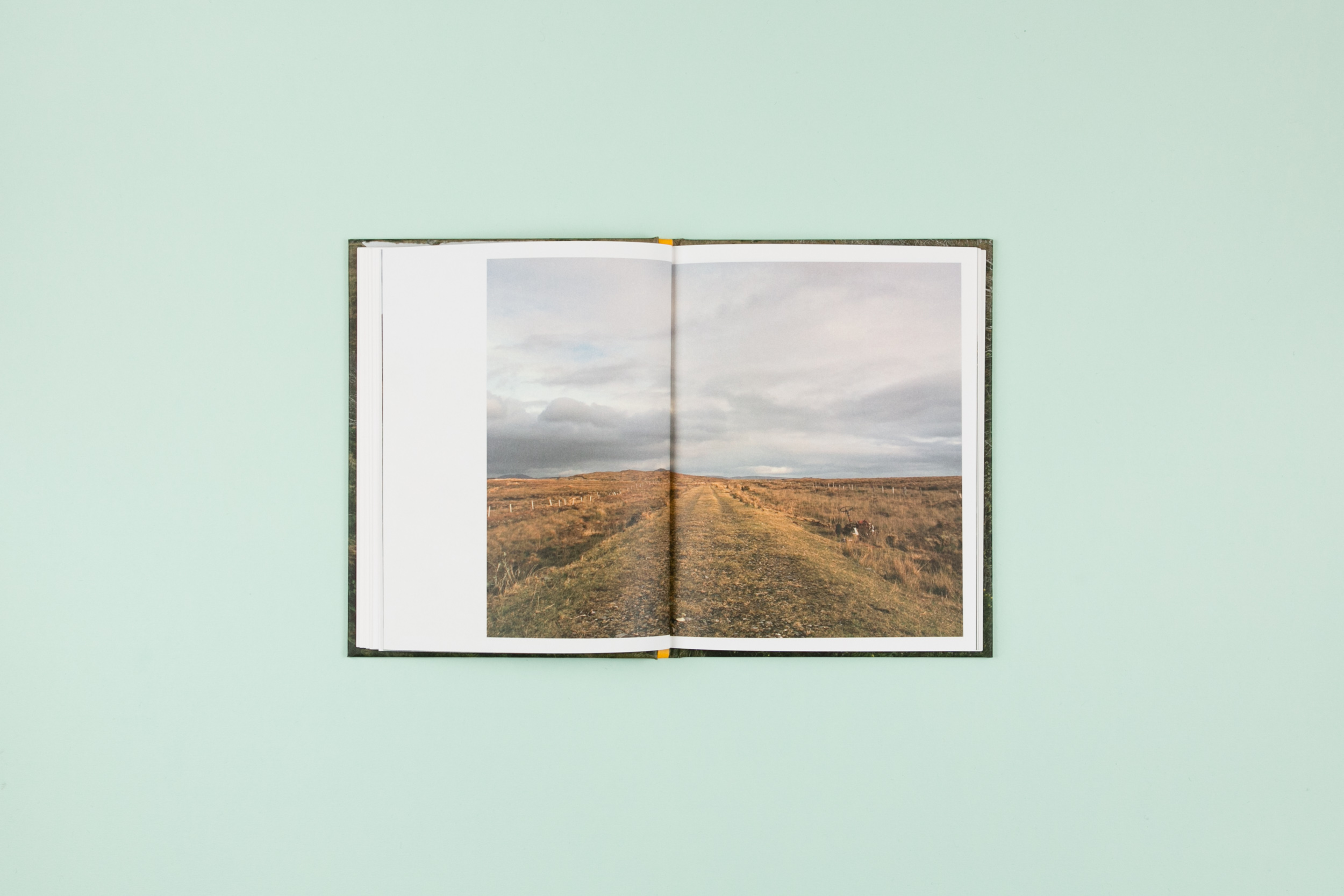 Book spread from 'The Whistle Blowing', a photobook featuring photography by Lorraine Tuck. Self-published and designed in collaboration with Read That Image.