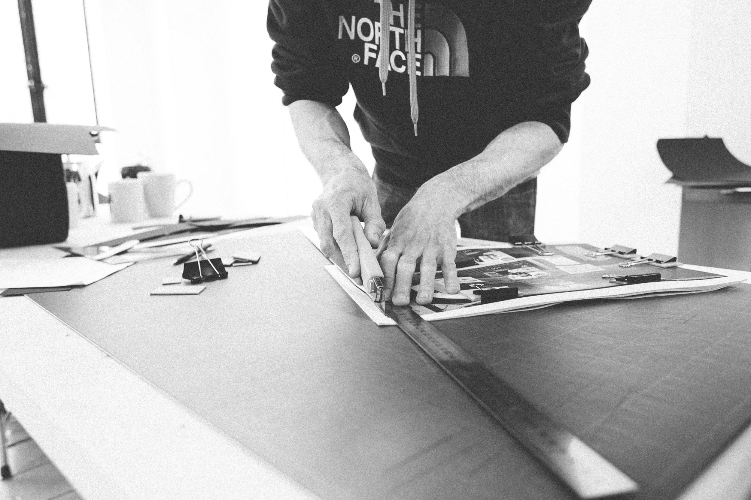 Read That Image member Barry Keogh cutting down printed sheets in preparation for photobook dummy binding during Make a Photobook workshop in Temple Bar Gallery and Studios.