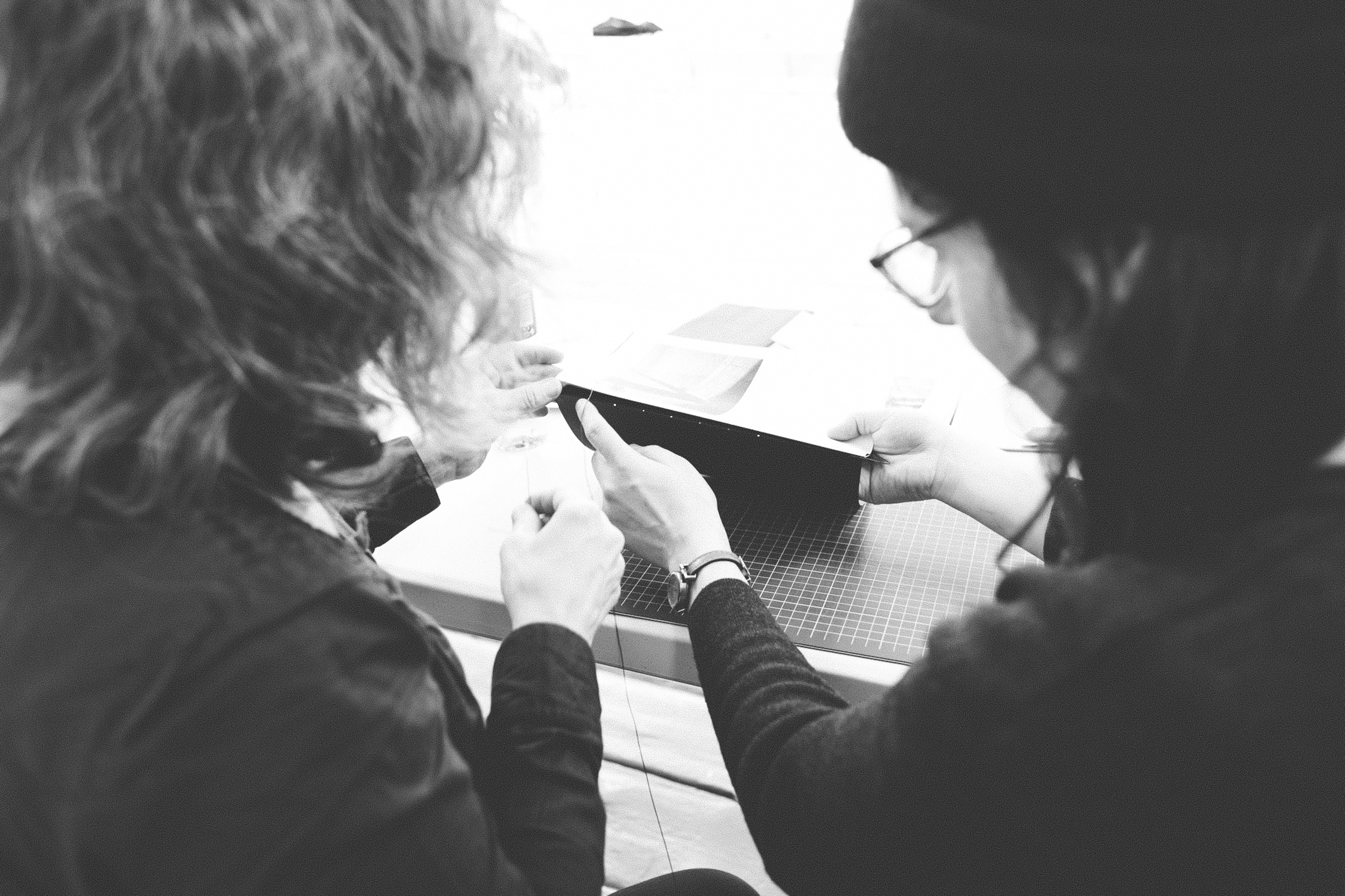 Read That Image member Kasia Kaminska and photographer Esther Moliné binding her photobook dummy 'Five Streets'