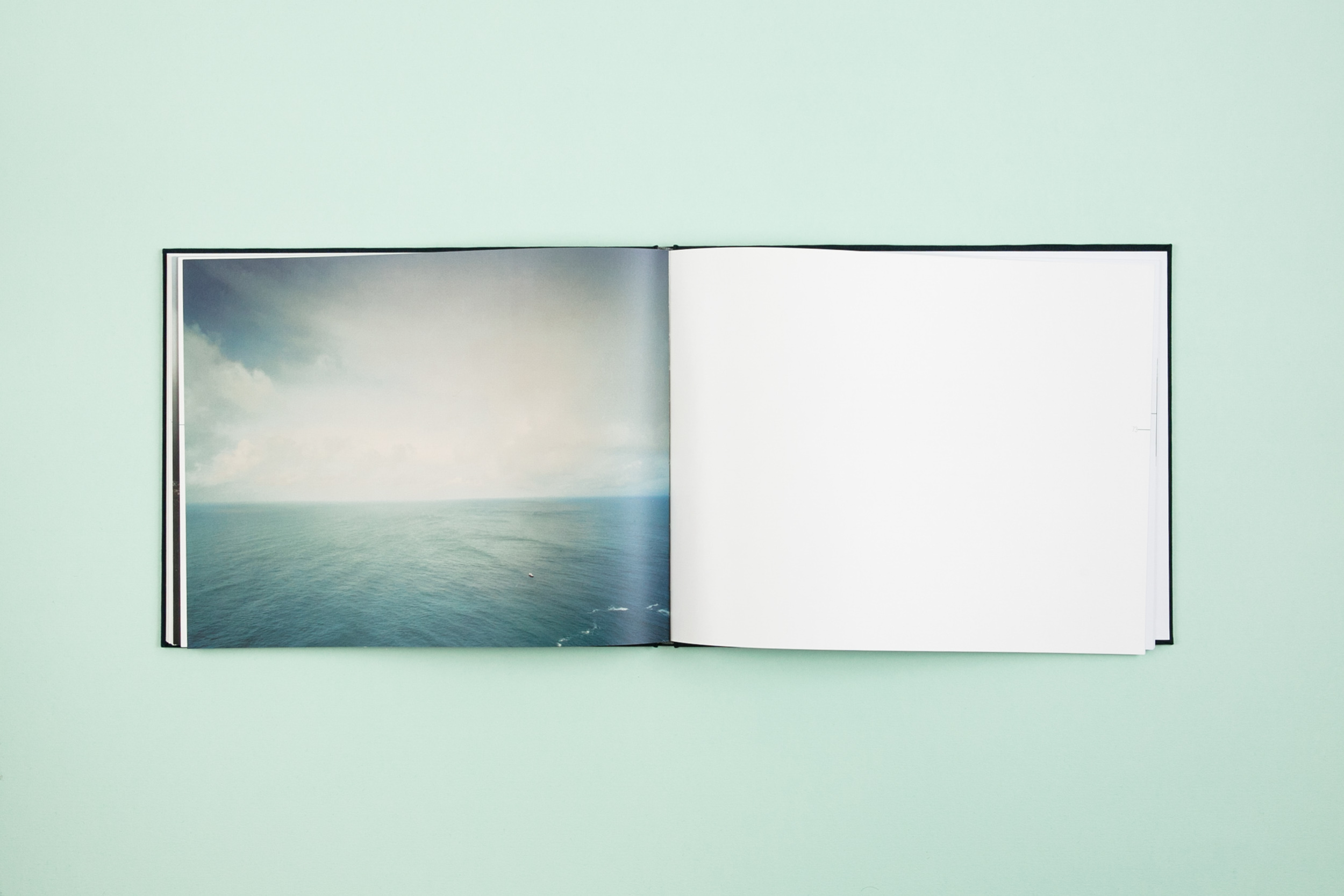 Book spread from self-published photobook 'Skyline' featuring photography by Eoghan Kavanagh and design by Read That Image.
