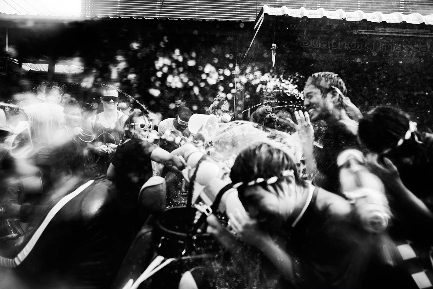 The great annual water festival, goes by many names in Southeast Asia, in Thailand it's known as Songkran. It ushers in the start of rainy season in April, a time when after five excruciatingly dry months the sky finally opens and water pours on to the bone dry land. It's celebrated nationwide with mass water fights and traditional Buddhist rituals. The Northern Thai city of Chiang Mai is widely known for where the water really gets flowing.  I documented Songkran from the perspective of a participant, to allow my audience to immerse themselves in the carnival atmosphere as if taking part with their own water pistol in hand. The only difference was that instead of shooting a water pistol I was shooting a camera wrapped in plastic.