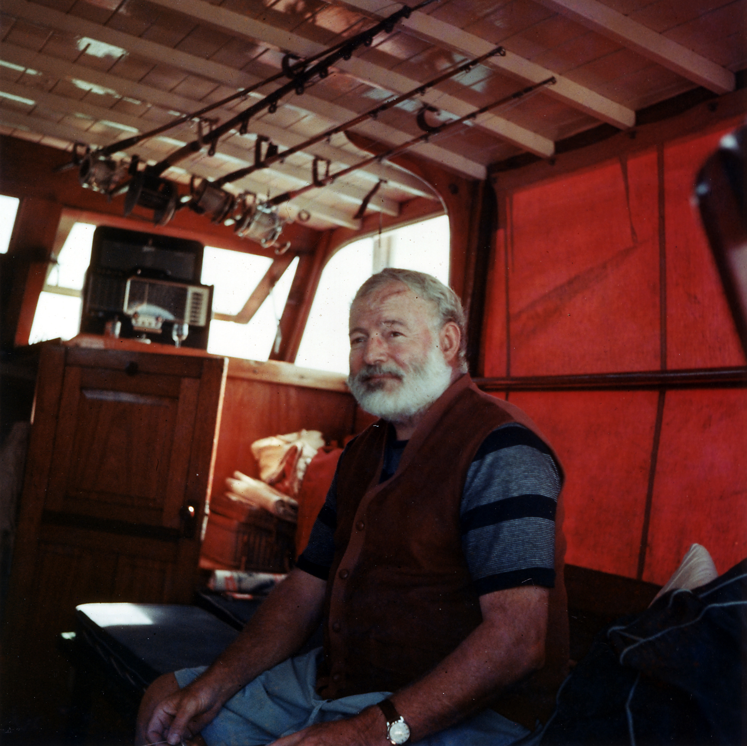 Ernest Hemingway in the cabin of his boat  Pilar , off the coast of Cuba, 1950. Credit: Wikipedia.org.