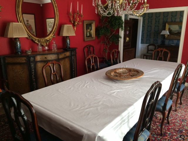 The White Table Cloth Ready To Be Signed (This is where we will eat, however image 4 highchairs, and two more chairs with booster seats.).