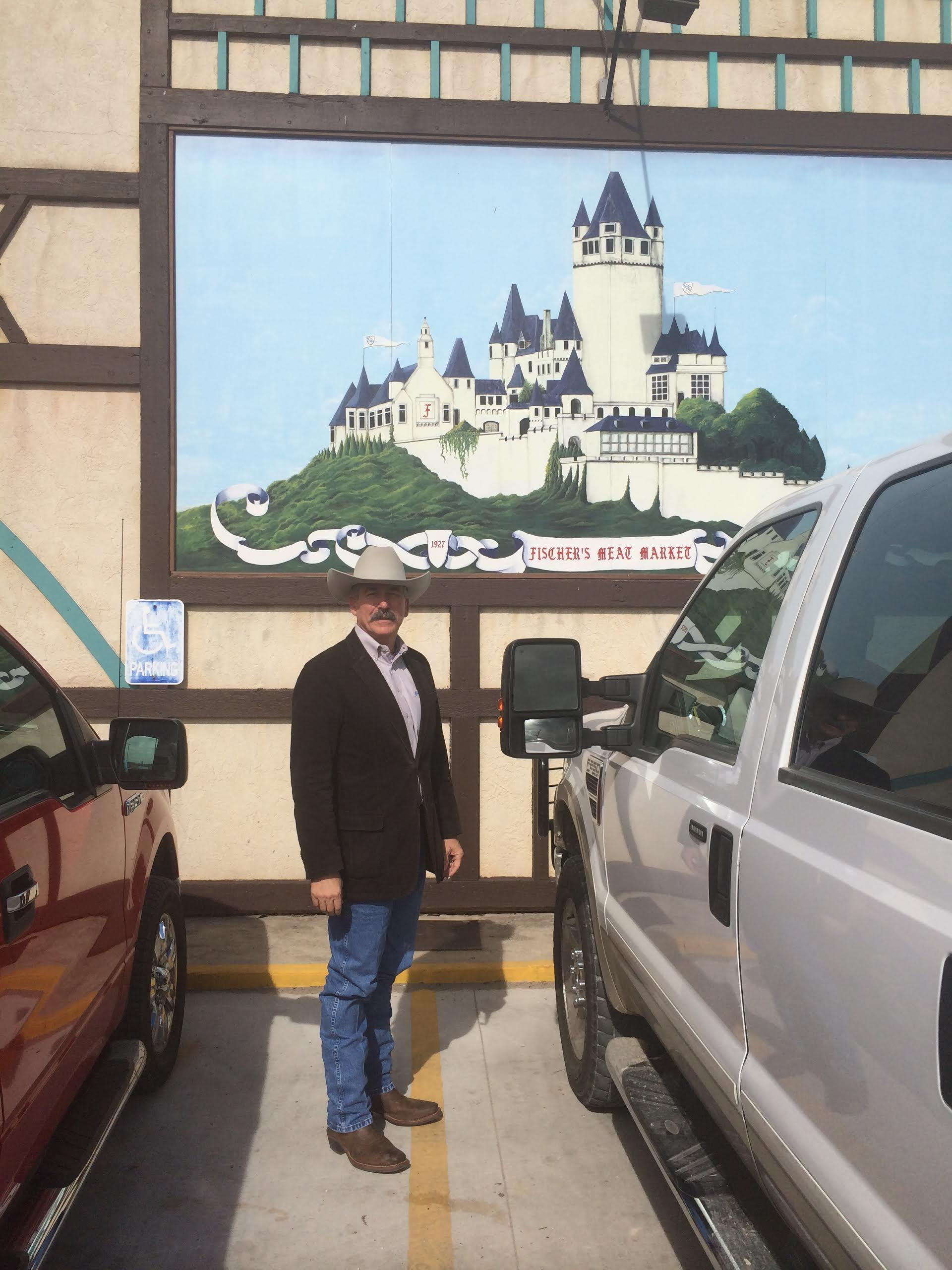 "Muenster is a quaint little town with a unique German heritage.  Check out the ""German castle"" mural on the Fischer building behind me."