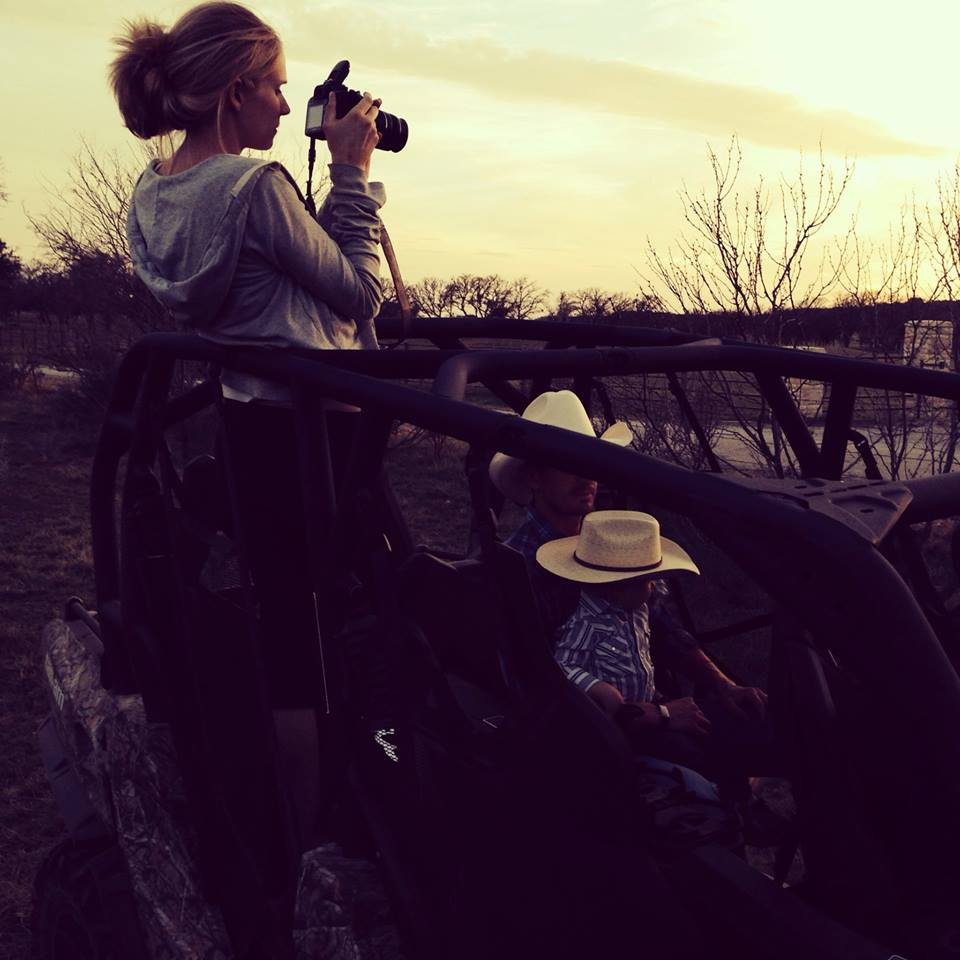 Holly snapping some pictures of the sunset with her two favorite cowboys tagging along.