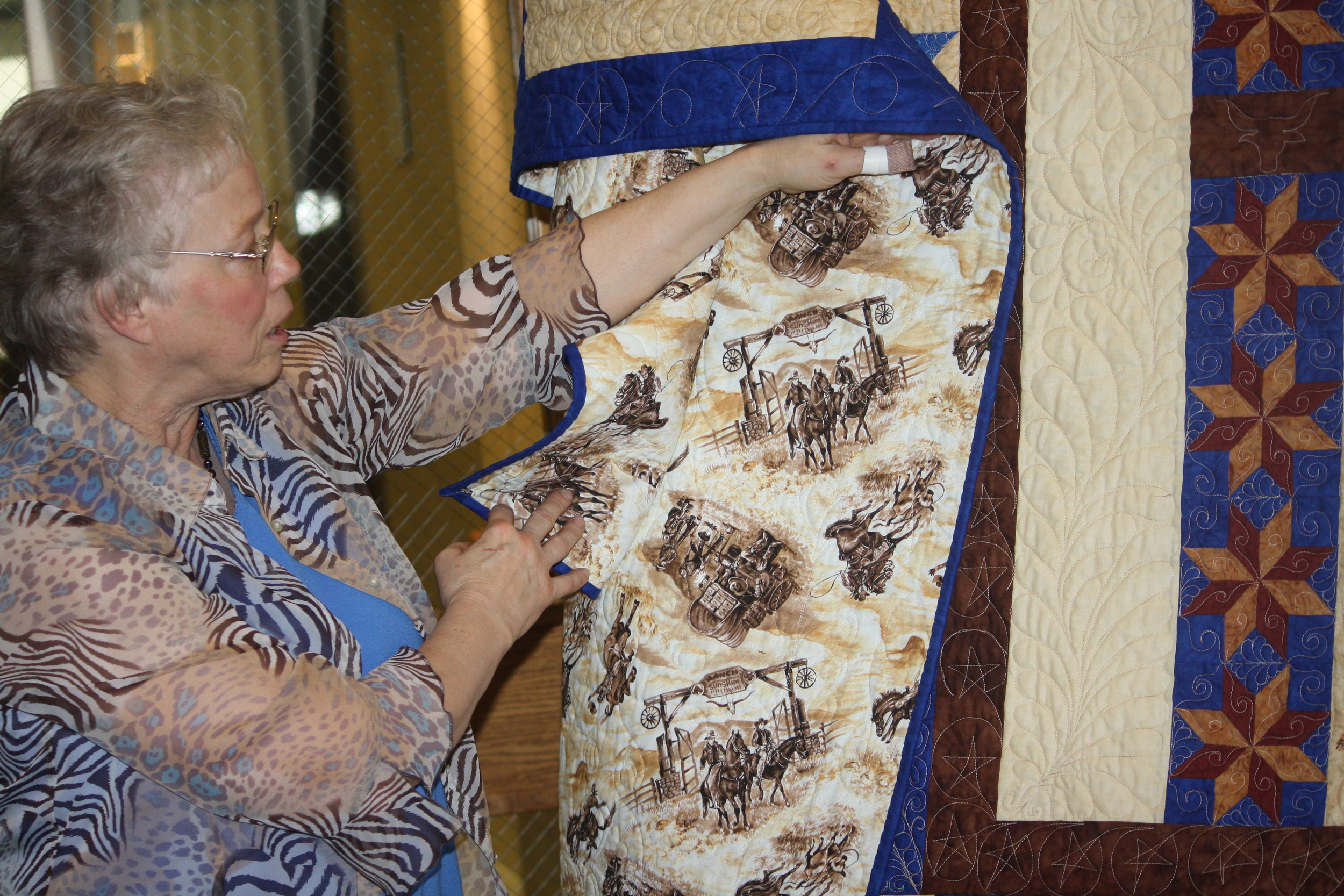 Frances showing the backside of the quilt.