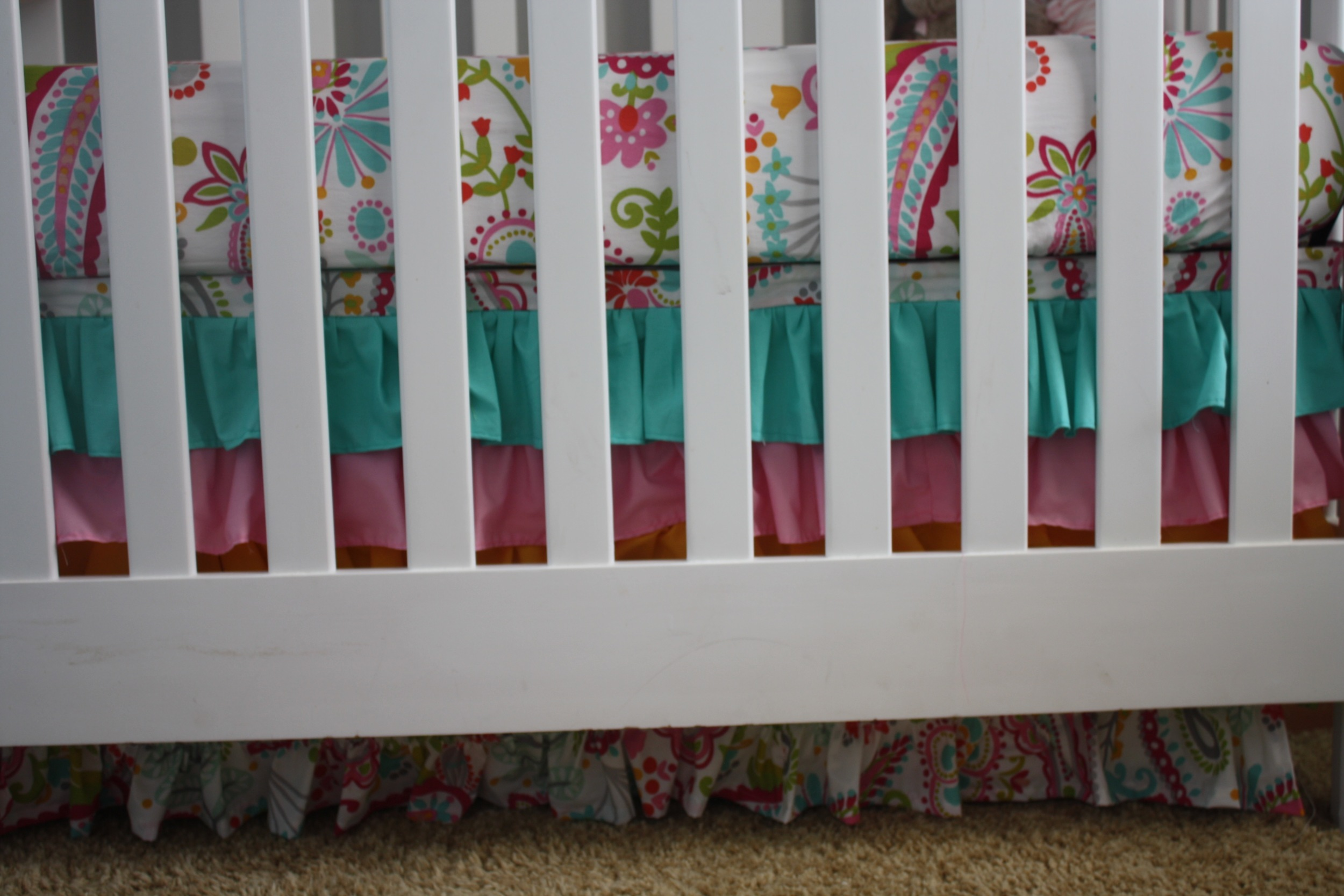 The crib skirt with ruffles. A little secret... they used Velcro to attach it to the bed frame so that they can remove it and made the bed skirt the right length as Cowgirl A grows and the bed gets lowered. This also saved them from having to make a 4th panel of crib skirt for the side along the wall!