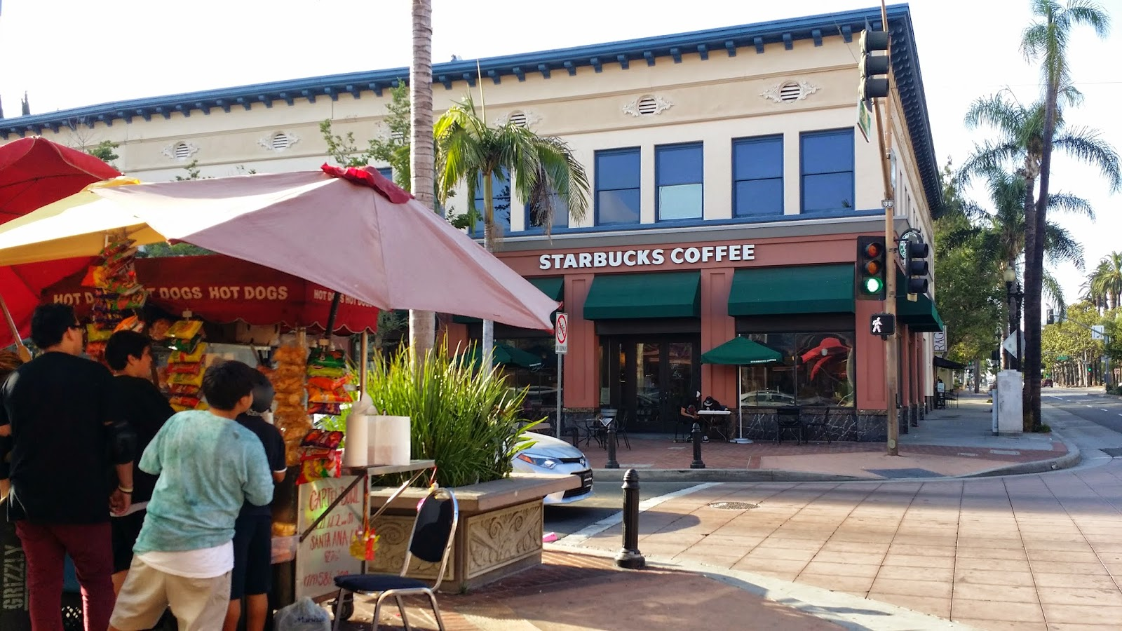 Traditional Downtown Santa Ana street vendor juxtaposed with their new modern  neighbors, Starbucks Coffee.