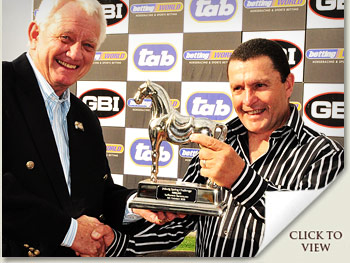 trainer of pierre jourdan, gary alexander, receiving joburg spring challenge trophy