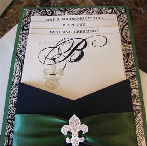 Invitations with fleurdelis accents and ribbons