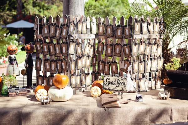 Love this idea for the guest book and escort card table. The pumpkins are a great touch.