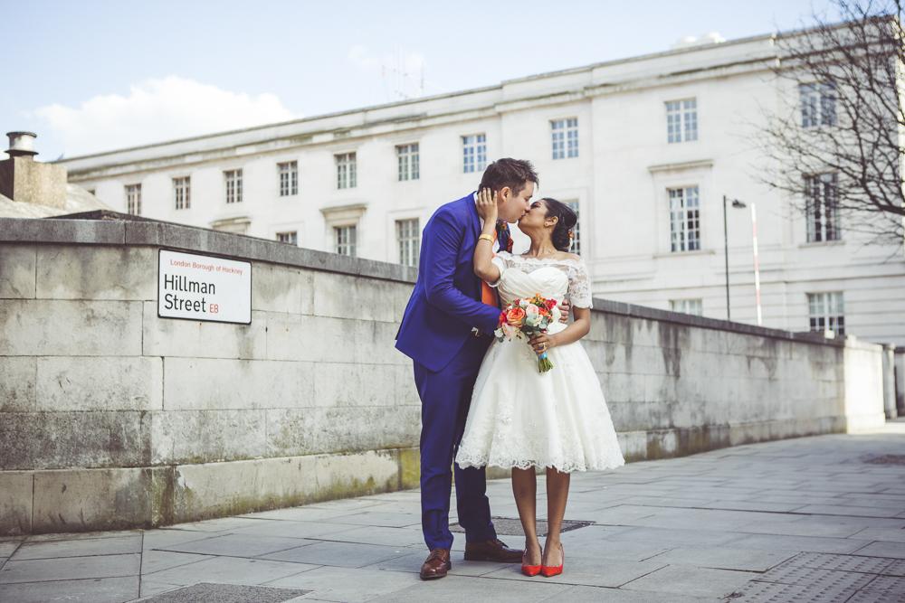 Bride and groom kiss Hackney