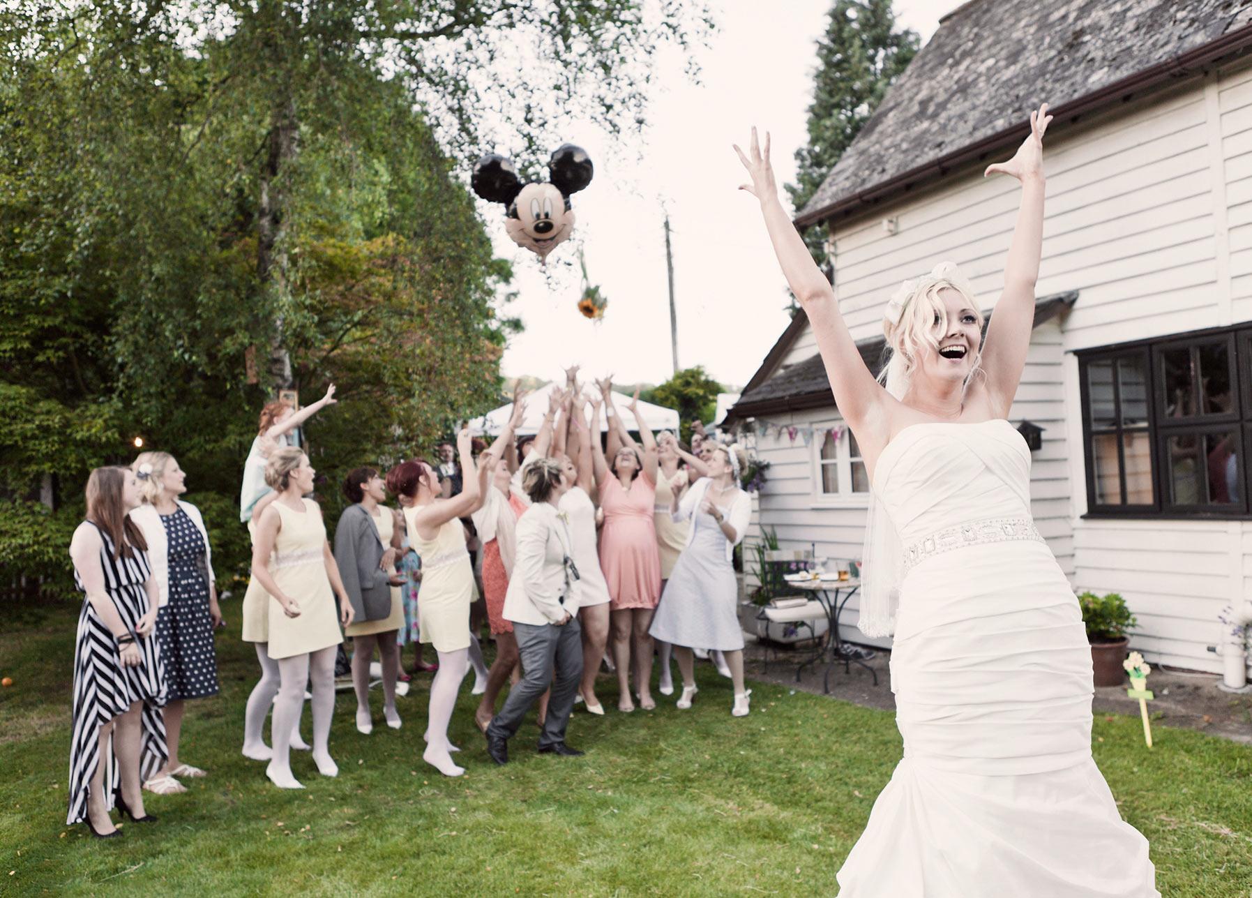 Bride throwing her wedding bouquet