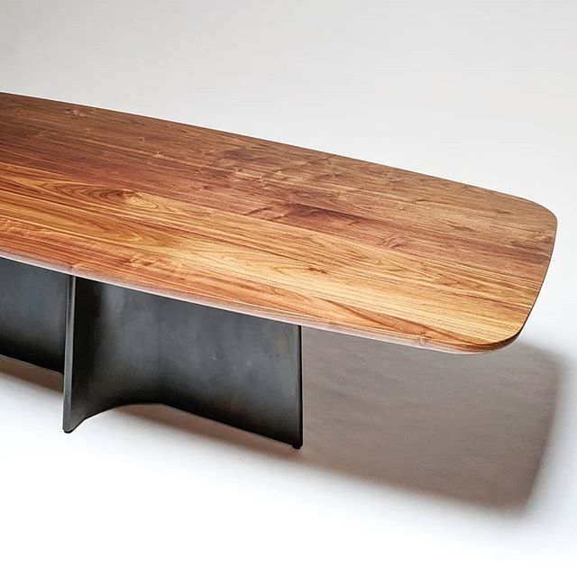 "I'll be bringing this table to the @craftcouncil show in San Francisco Friday through Sunday. I have a handful of passes, so dm me if you would like one.  This table has a Button Steel base with a custom walnut top (does one call this shape ""surfboard""?). @lginteriors was generous enough to let me exhibit this before delivery, so please keep your filthy hands off it so she doesn't regret it! . . . #buttonsteel #buttondining #diningtable #kitchentable #pedestaltable #surfboardtable #steeltable #diningroomdesign #interiors #interiordesign #kitchendecor #diningroom #sanfrancisco #furnitureporn #sfmade"