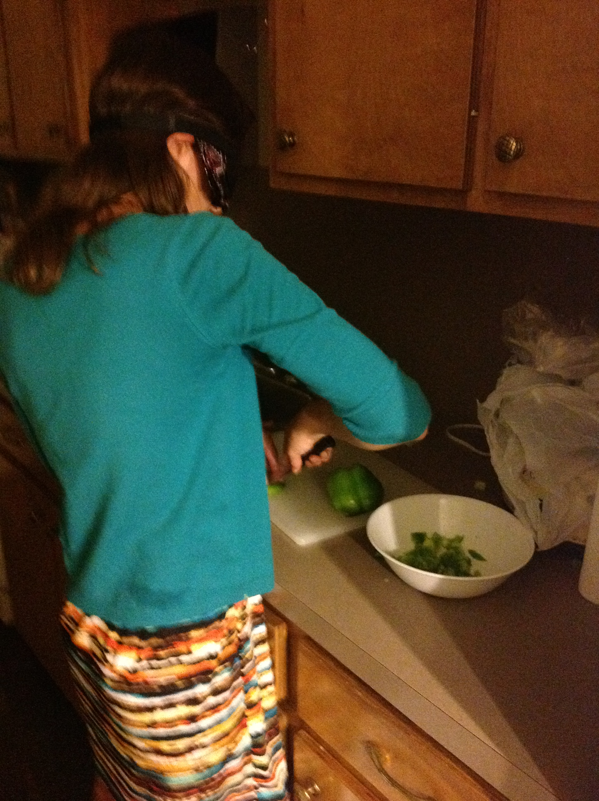 Nicole chops a bell pepper in Home Economics class.