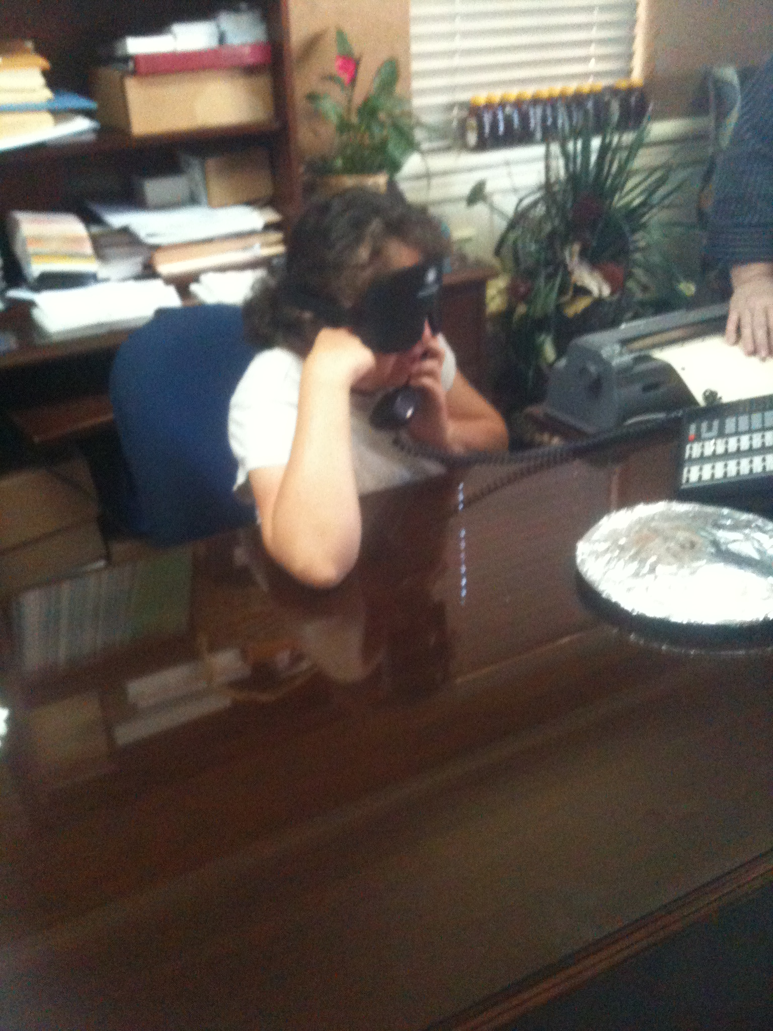 Nicole answers phones as part of her summer work experience.