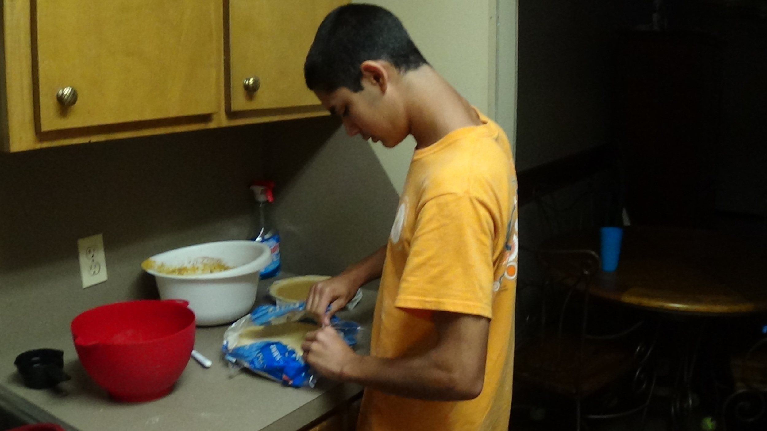 Roman prepares the pumpkin pie for his Thanksgiving feast for 16!