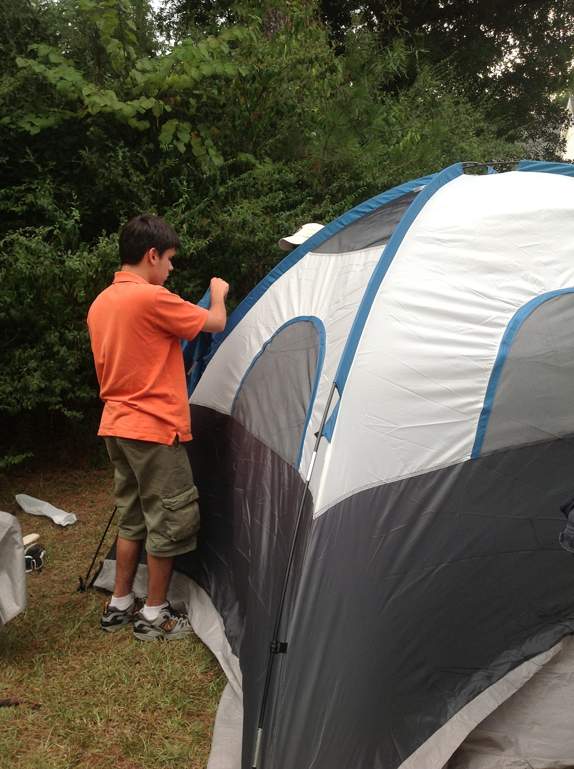 Stephen helps to build a tent