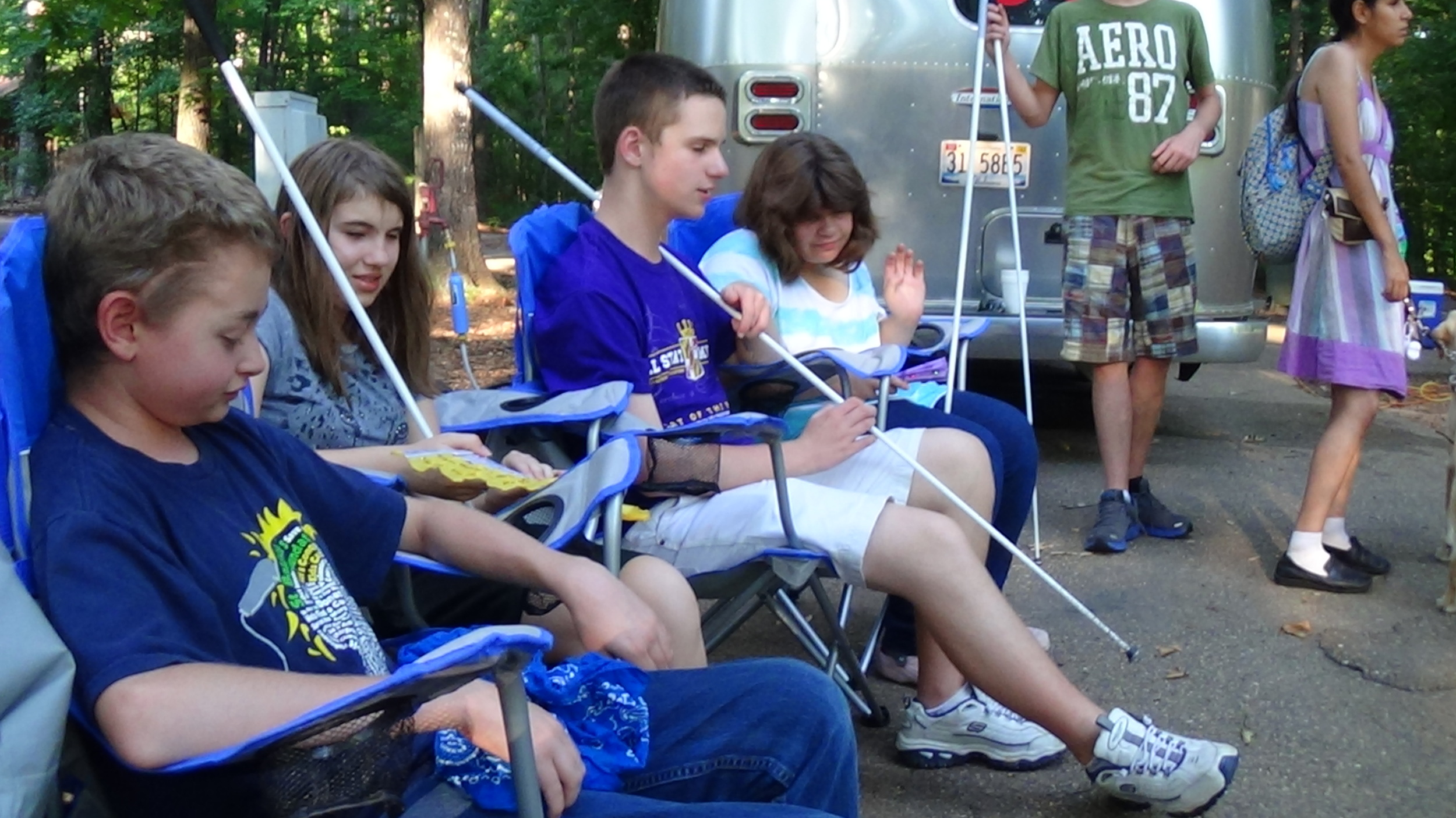 2013 STEP students chill and talk at a campsite.