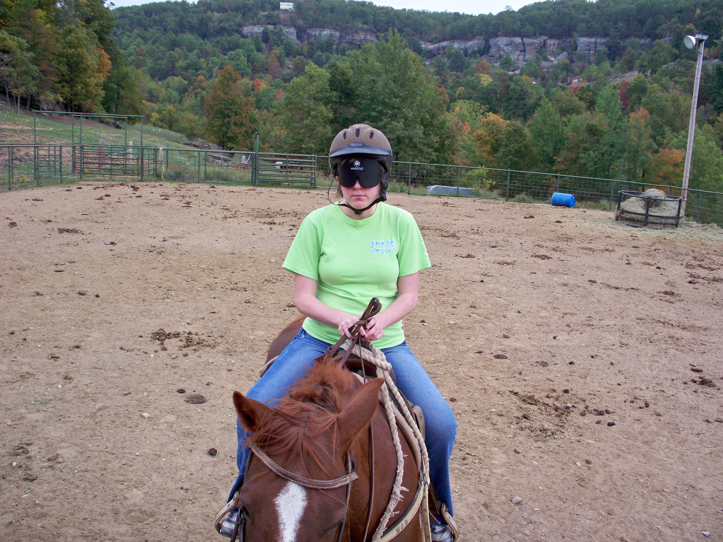 Katie riding her horse in the arena at HCR