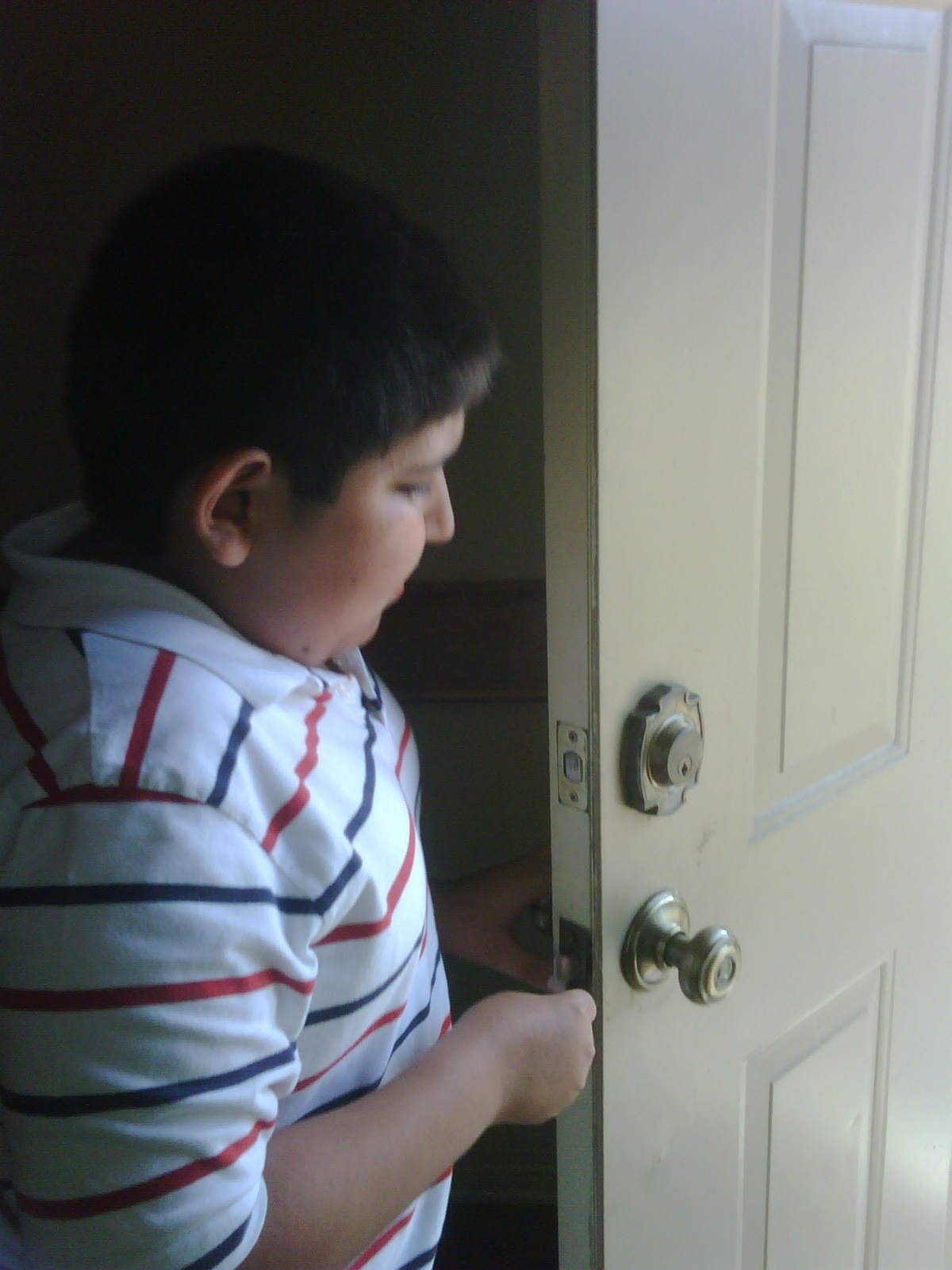 Buddy student fixing a doorknob