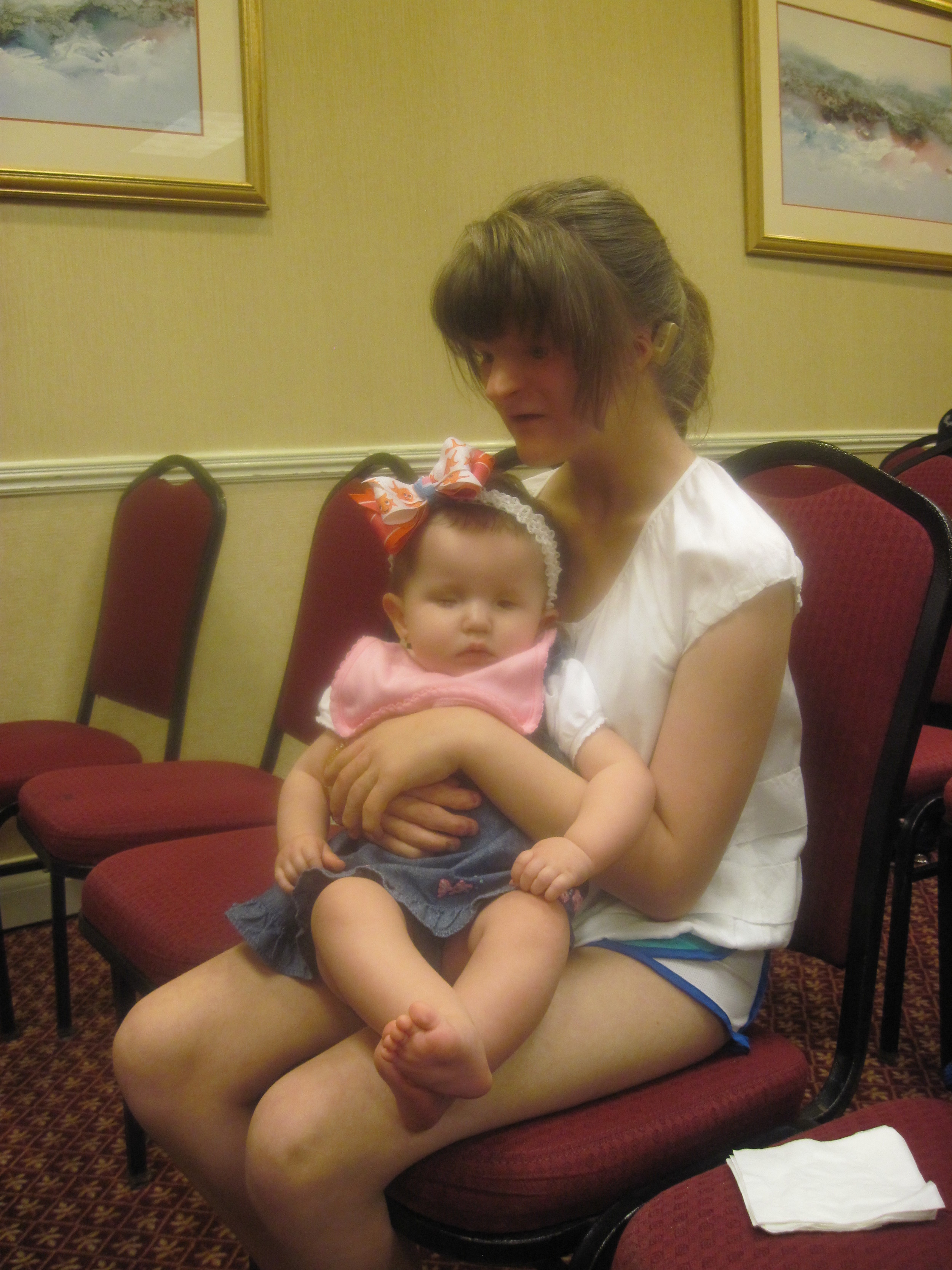 Sophie (in our Infant/Toddler program years ago) holds Addison
