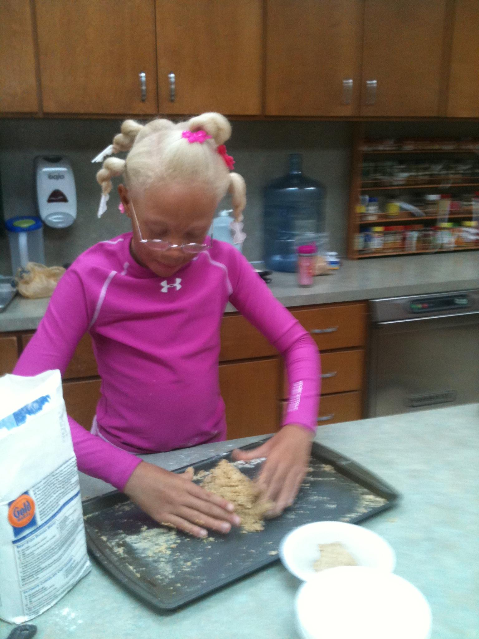 Kiona pounds her edible playdoh