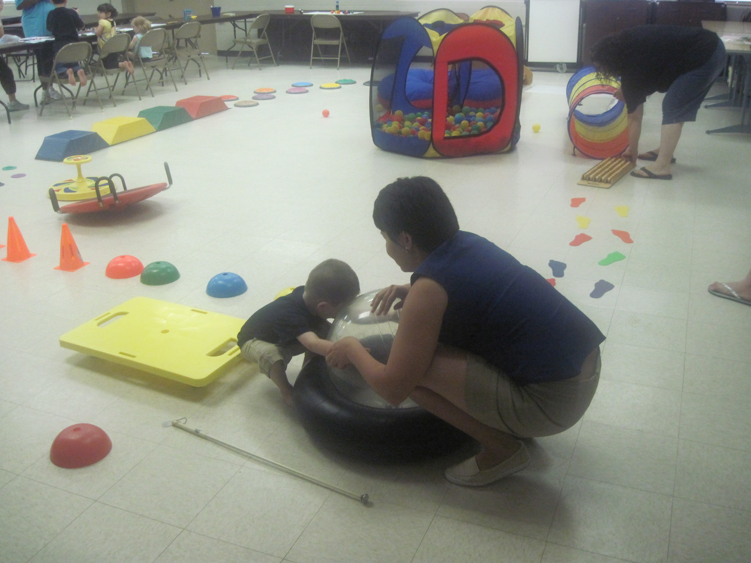 Jordan and Elnora enjoy playing on the tactile obstacle course