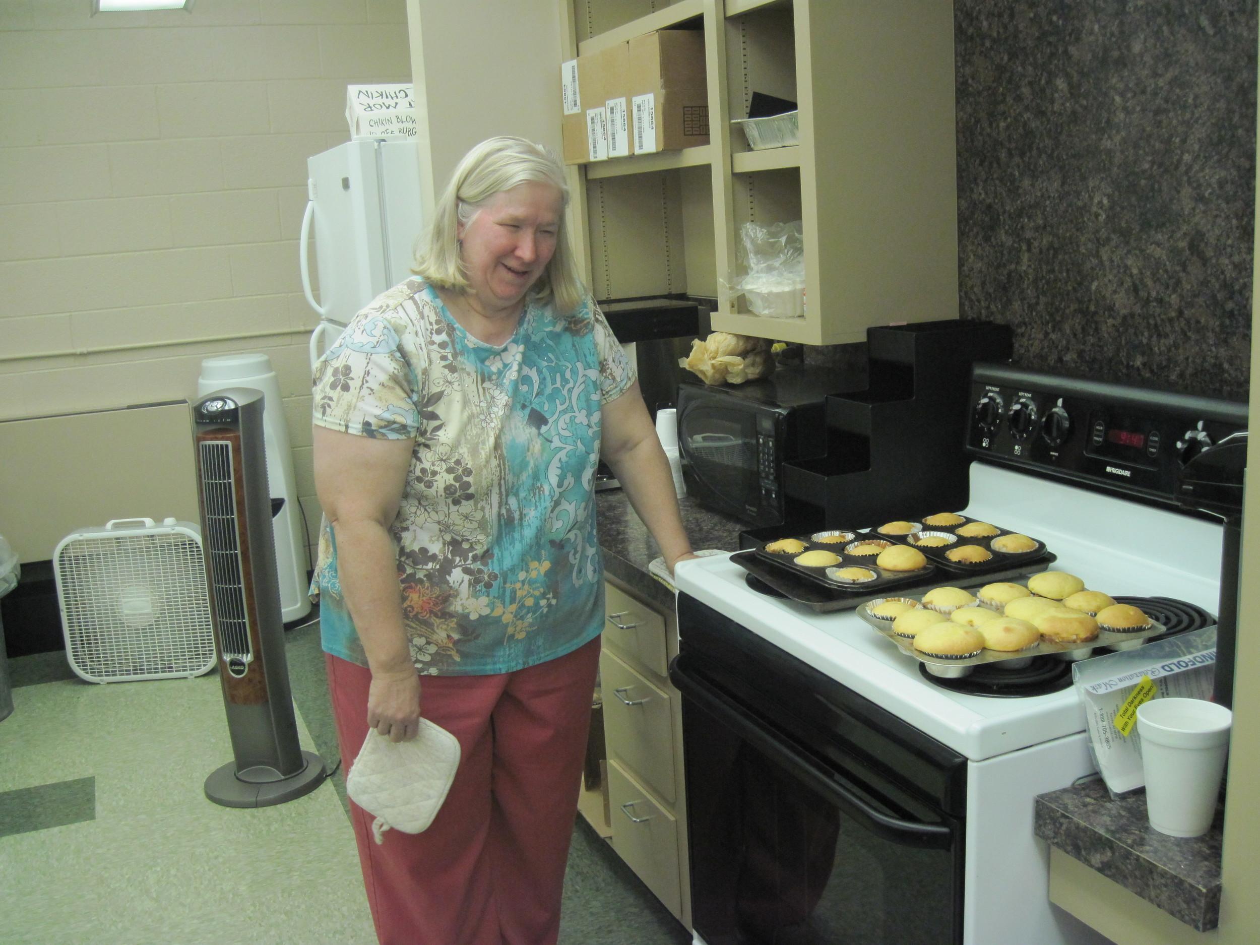 Zena assists in tecahing baking non-visually