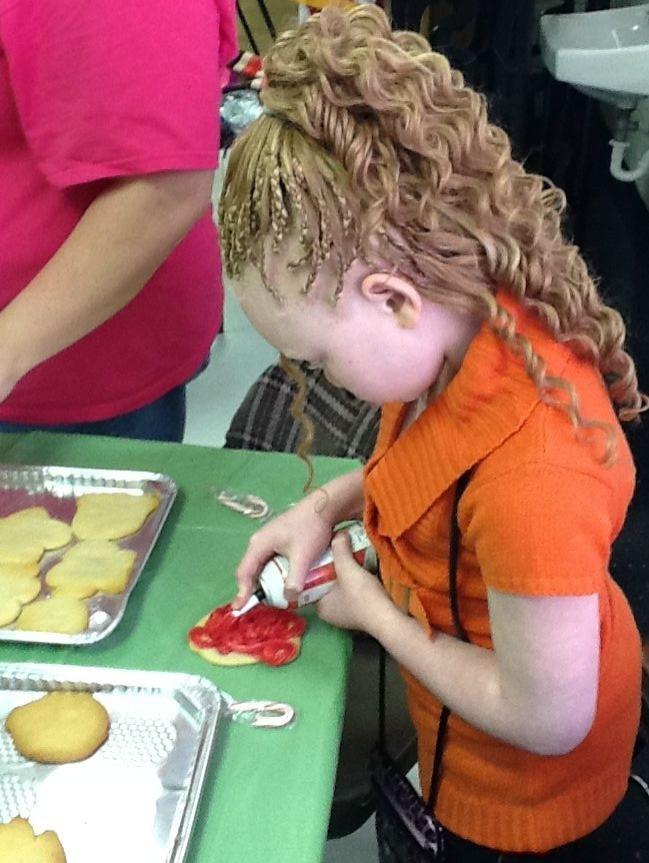 Rekendra decorates her cookie