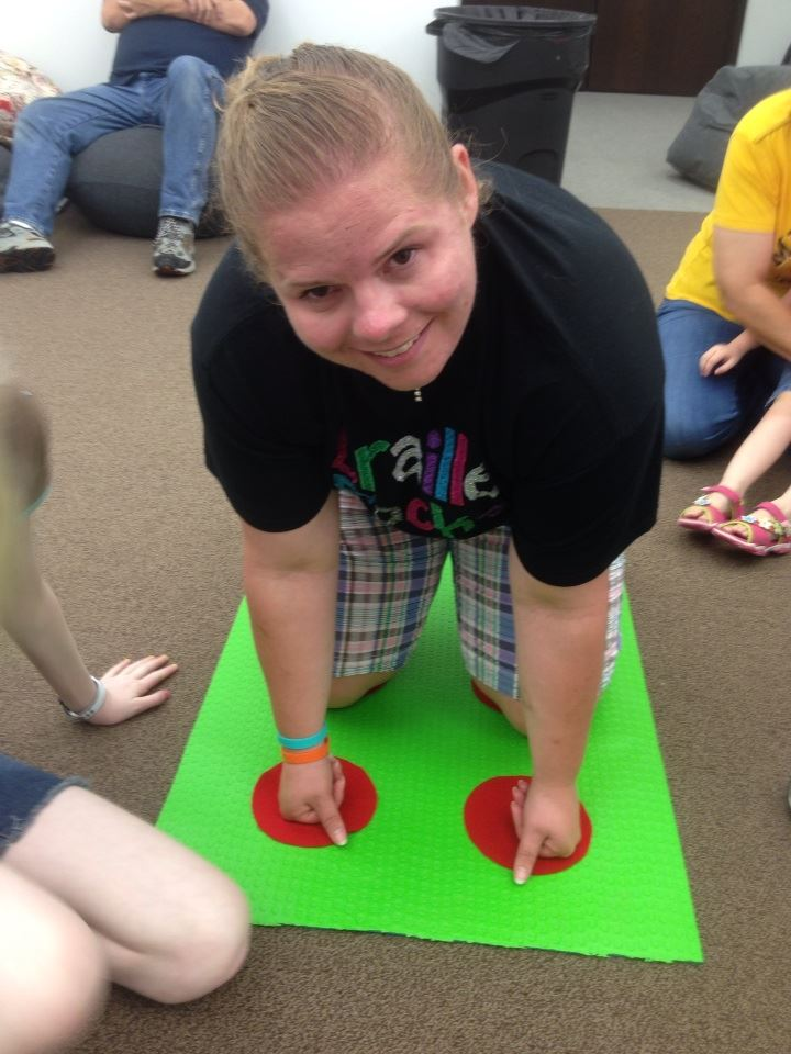 Natalie Shaheen make a for sign on the braille twister board!