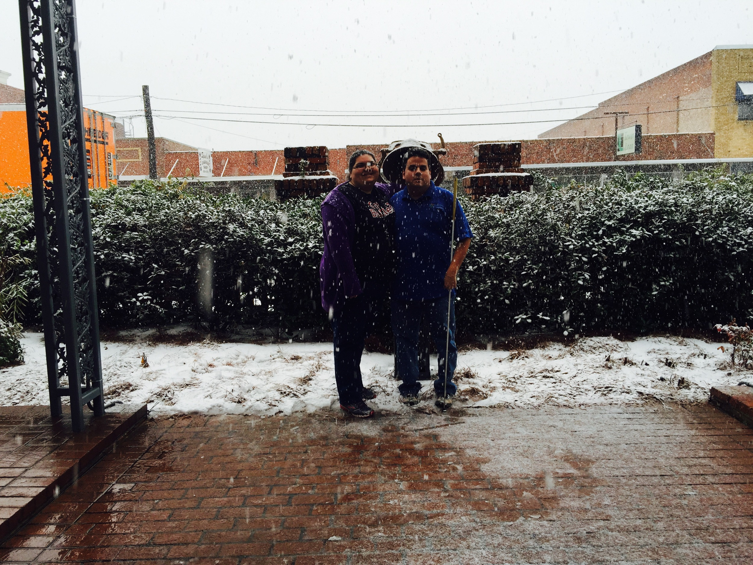 Eric and Krystal in the snow by the freedom bell