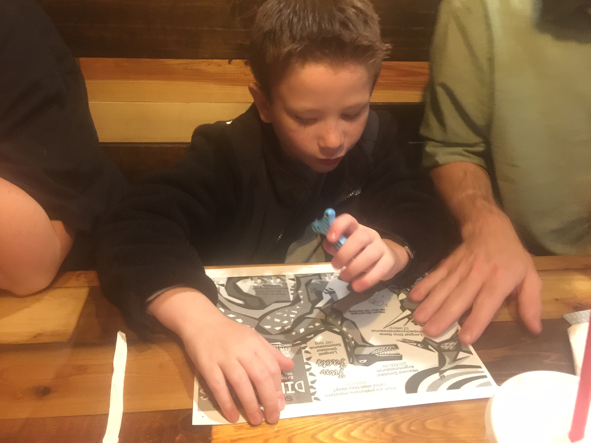 Jordan scribbling with a slate-n-stylus at dinner before the big challenge!