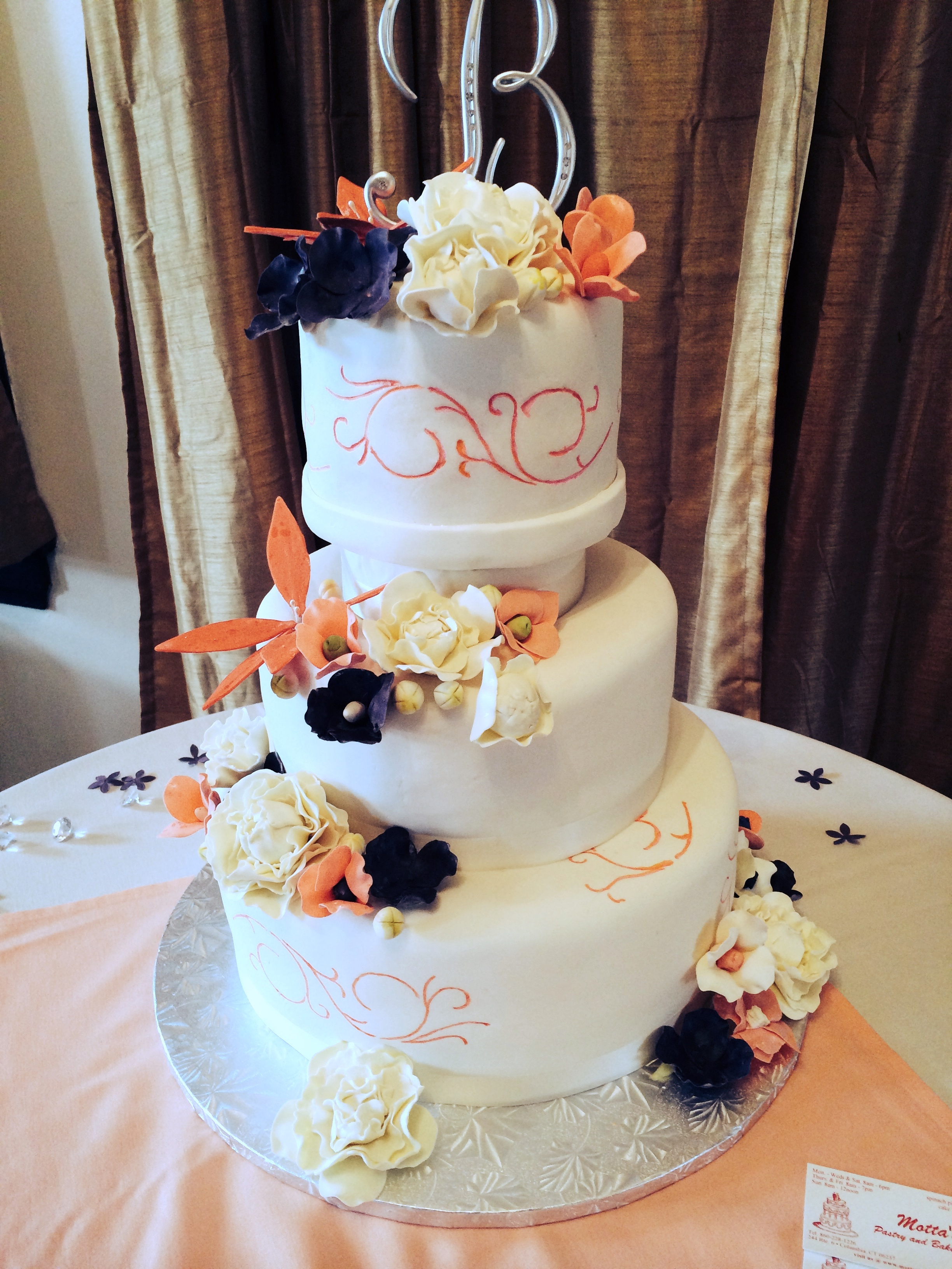 Wedding Cake Orange Flowers.jpg