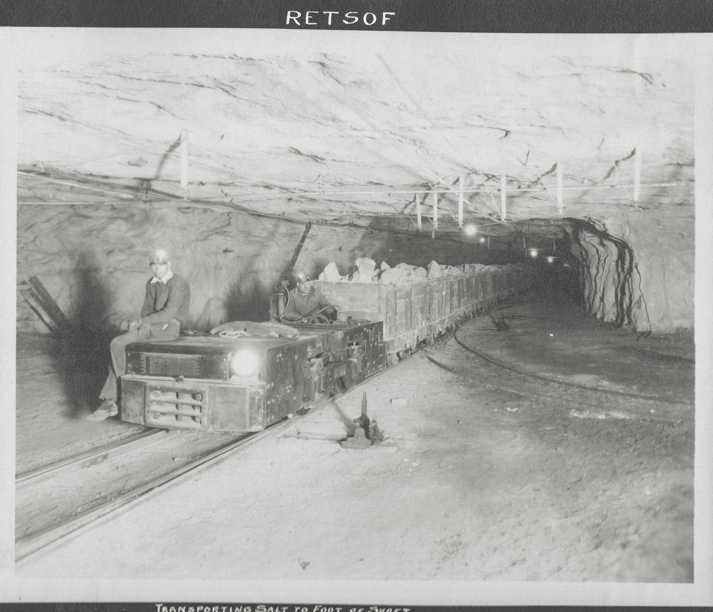 Transporting salt to foot of shaft in the Retsof Salt Mine.