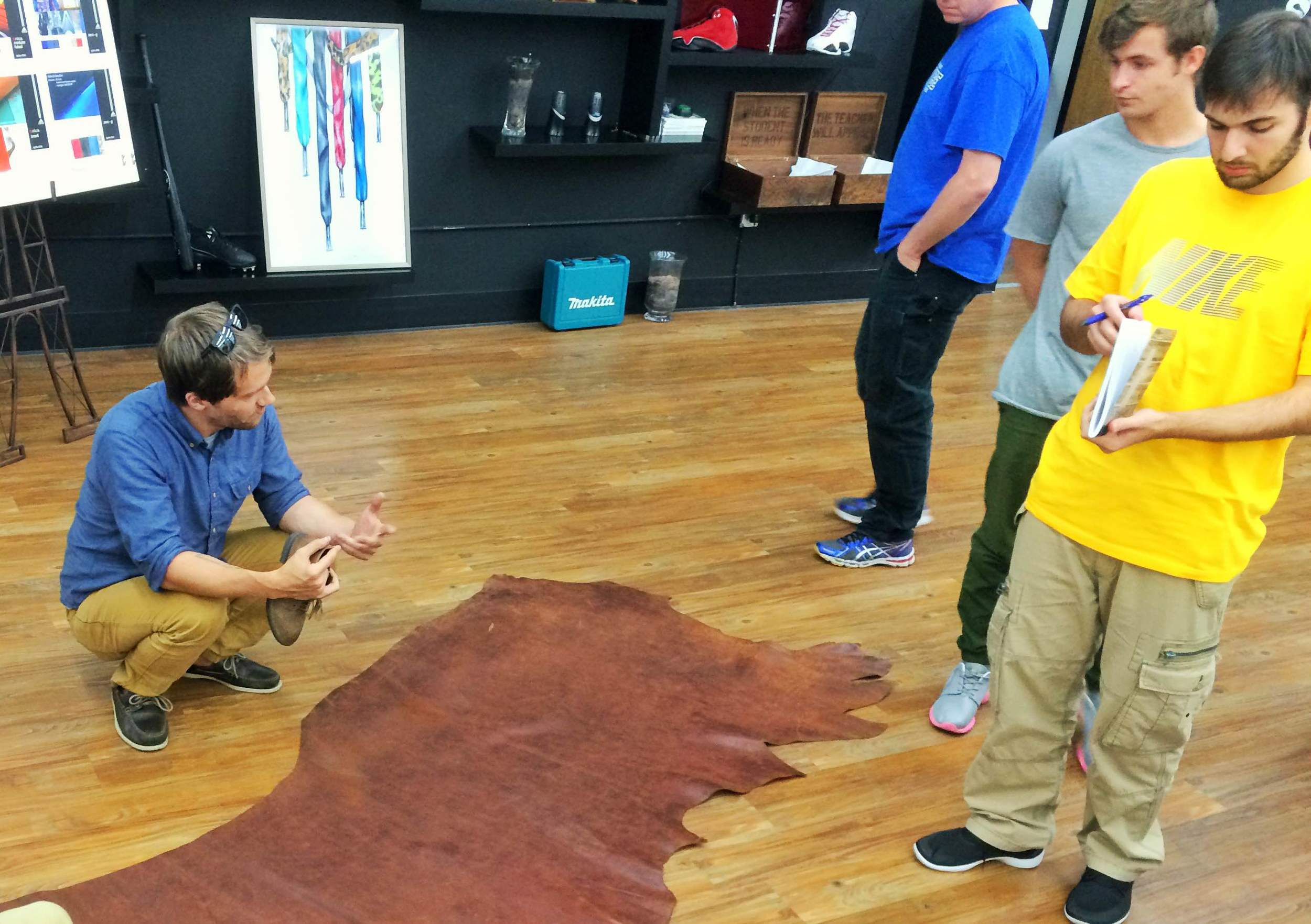 Austin showing off the entire side of a leather hide.