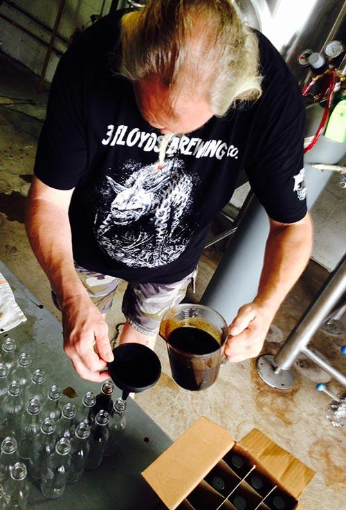 John filling bottles of our collabo hot sauce.