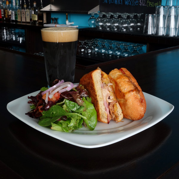 Brewmix Cube:Pork shoulder, ham, provolone cheese, dill pickles, mustard BBQ sauce. Served on crusty French roll with garlic butter. $10