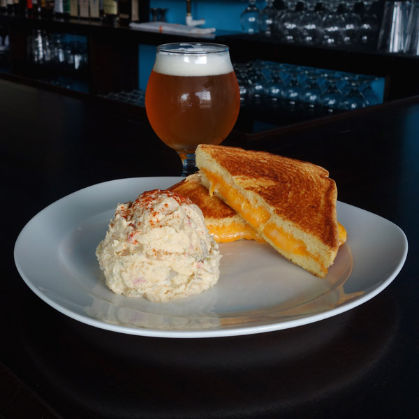 Grilled Cheese: Provolone cheese, cheddar cheese, Monterey jack cheese. Served on thick garlic buttered toast. $7