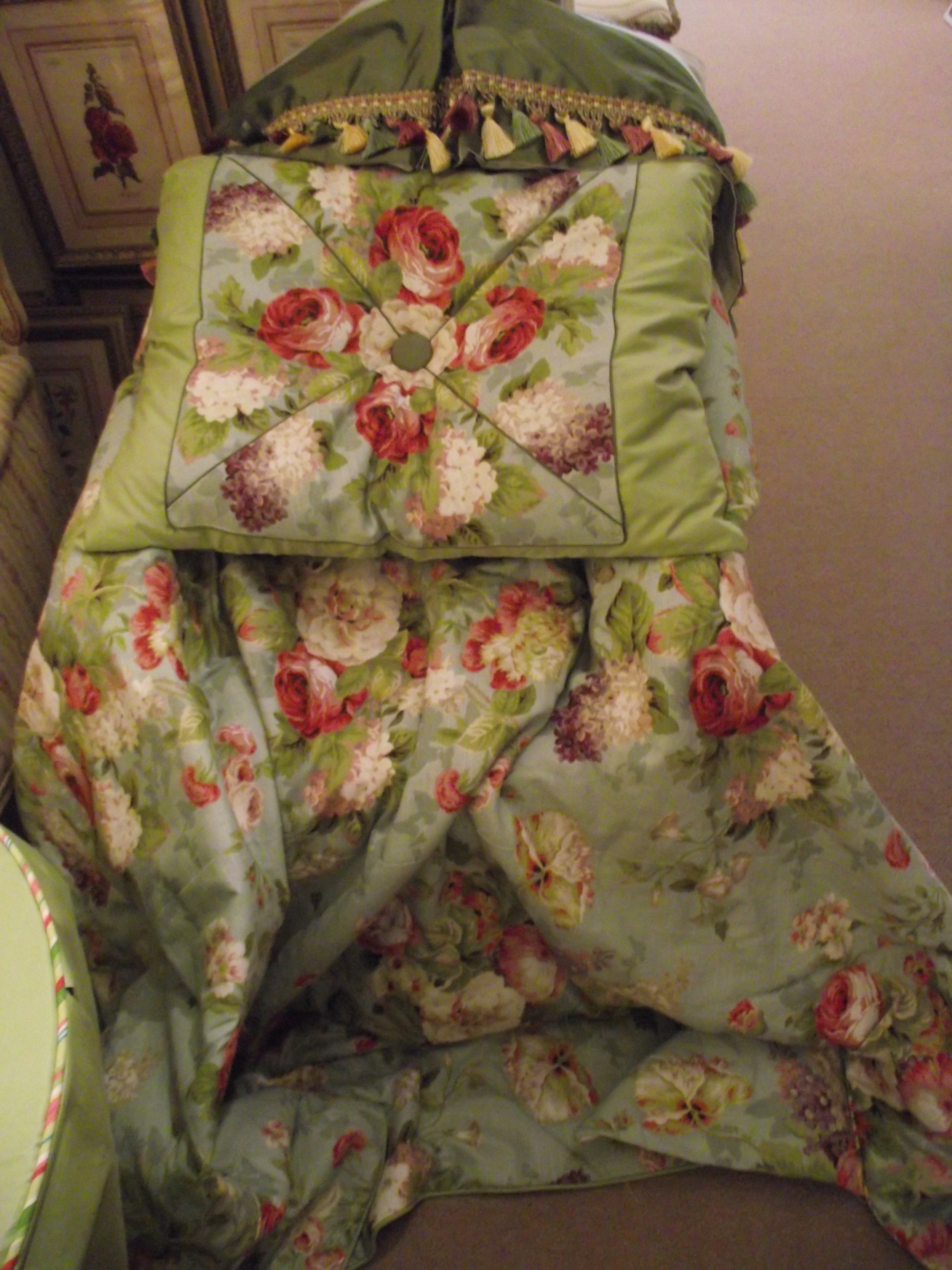 "The ""mitered Floral"" pillow sham shown on the comforter and dust ruffle."