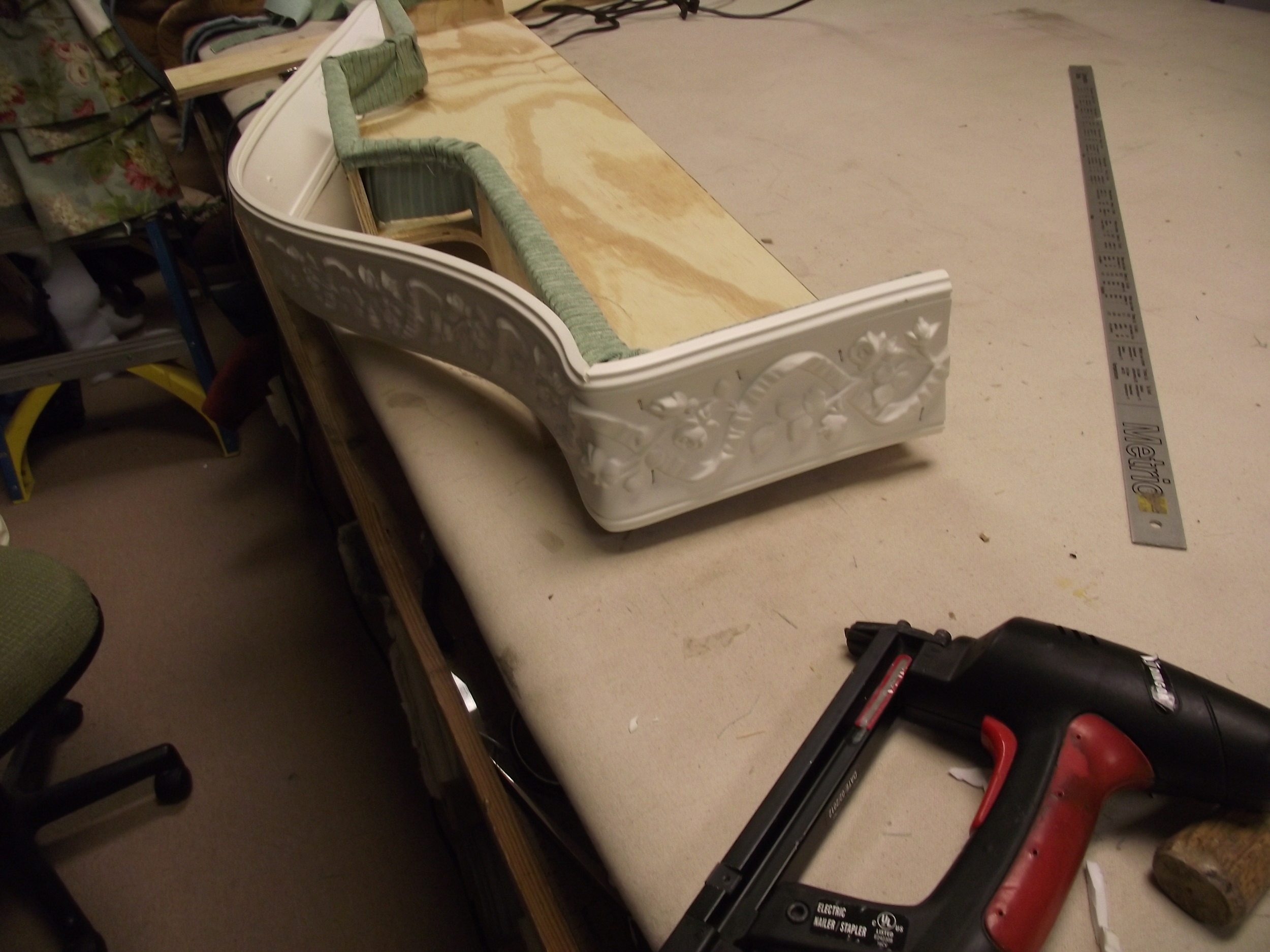 Bendable molding being attached to cornice frame. Notice the 45 degree corner.