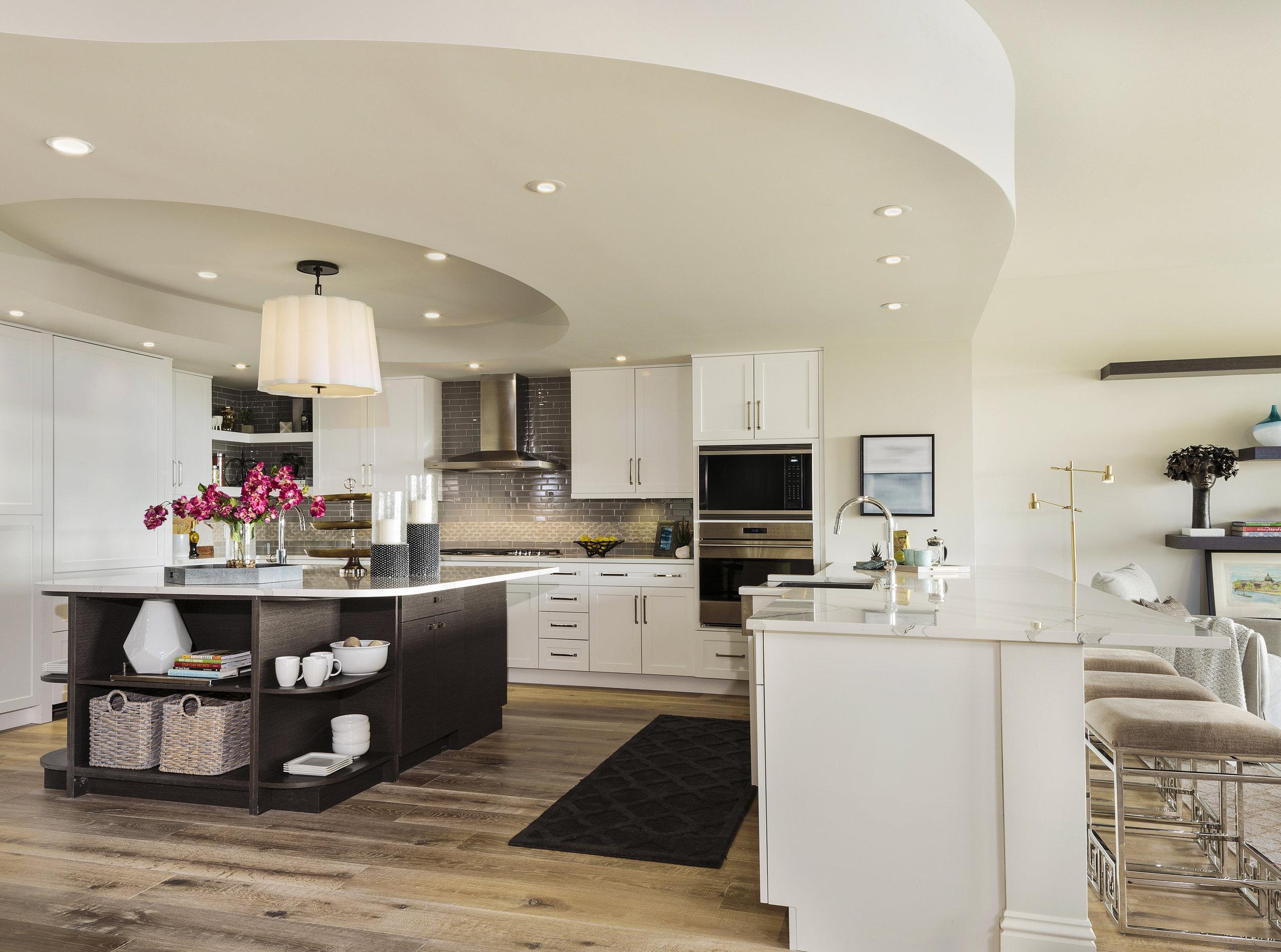 kitchen side 1 AQUA at Pelican Bay Condo 304 Design In Naples By Beasley & Henley Interior Design.jpg