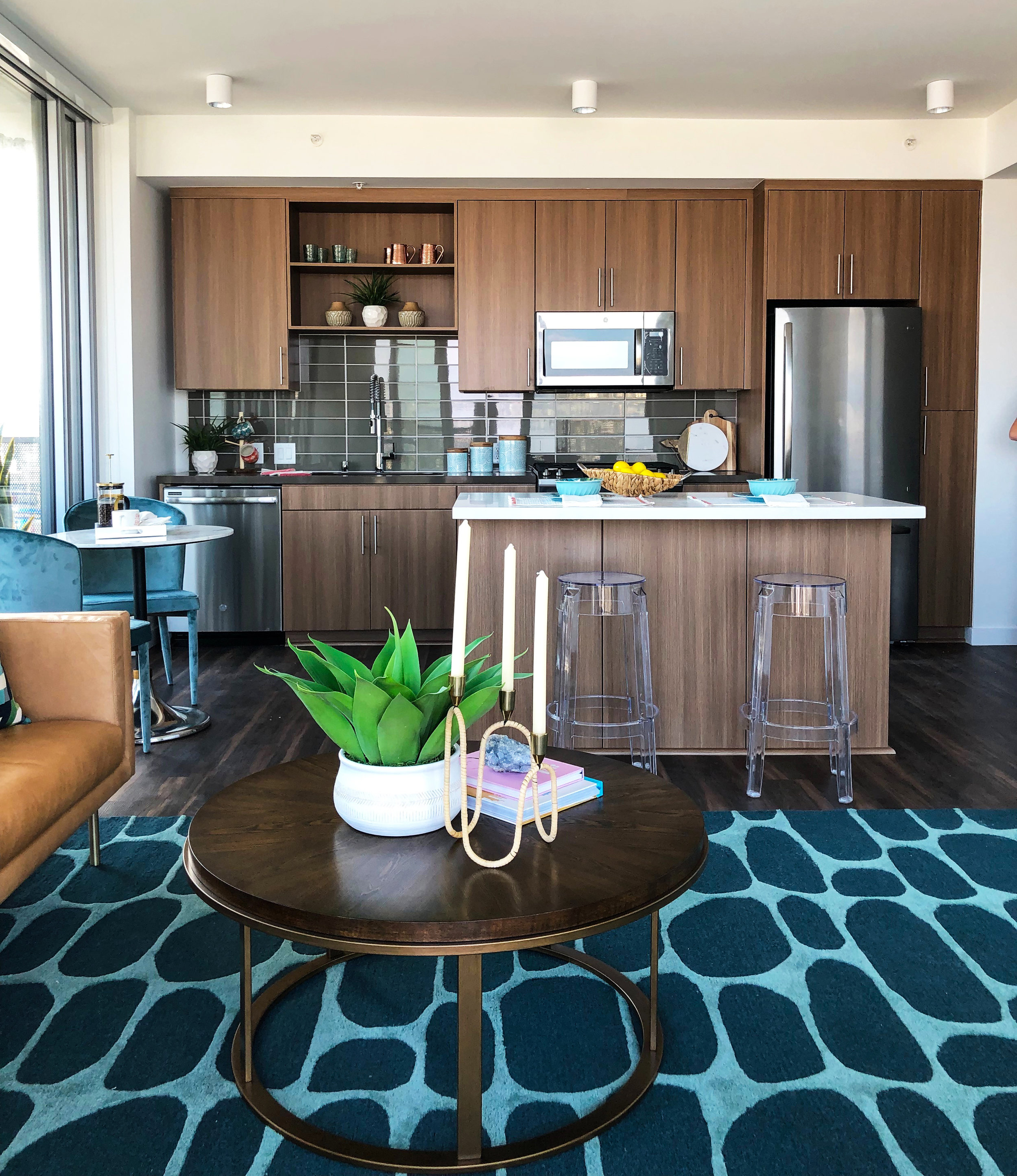 Create definition and beauty to a room. - You may see an area rug as something you just walk over, but in fact they are a very important design element in a room. Similar to a fabulous pair of shoes an area rug can either break or make an outfit and space. They are the perfect addition to create definition and beauty to a room. Not only can an area rug satisfy the most fashionable eye, it can also serve as an acoustical damper to heavy footsteps and create separation between rooms.The area rug trends we are excited about this year are bold geometric and distressed vintage prints, global inspired, cowhides, avant-garde designs, faux animal prints, shaggy synthetic fibers and abstract patterns. The very first step you take in selecting a rug is the room size. Measuring the room is key to ensuring the perfect fit. One of the biggest mistakes people make is selecting a rug that is too small for a large room, makingYour lifestyle should have an impact on the choice of rug in your main living areas. If the space is more relaxed then look for a more casual less formal rug. Go for an eye catching geometric pattern if you're looking to infuse your home with colorful personality. These gorgeous rugs are a great way to make a style statement with an on point trend. The distressed global styles can give a room the perfect vintage element that's gained popularity over the past few years. Cowhide rugs are sprucing up rooms across America in a big way. From modern to rustic these statement making home accessories are making bold statements in the most luxurious way.